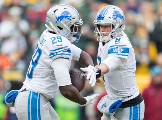 Lions quarterback Matthew Stafford hands the football off to running back LeGarrette Blount during the first half on Sunday, Dec. 30, 2018, in Green Bay, Wis.