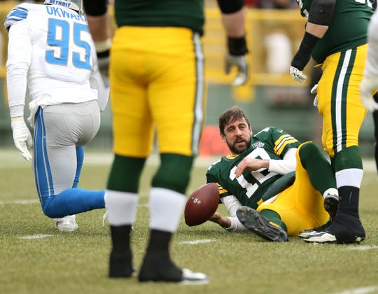 Packers quarterback Aaron Rodgers lays on the ground after being sacked by Lions defensive lineman Romeo Okwara during the first half on Sunday, Dec. 30, 2018, in Green Bay, Wis.