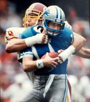 Washington Redskins Dean Hamel sacks Detroit Lions quarterback Eric Hipple in the second half in the game in Washington, DC.