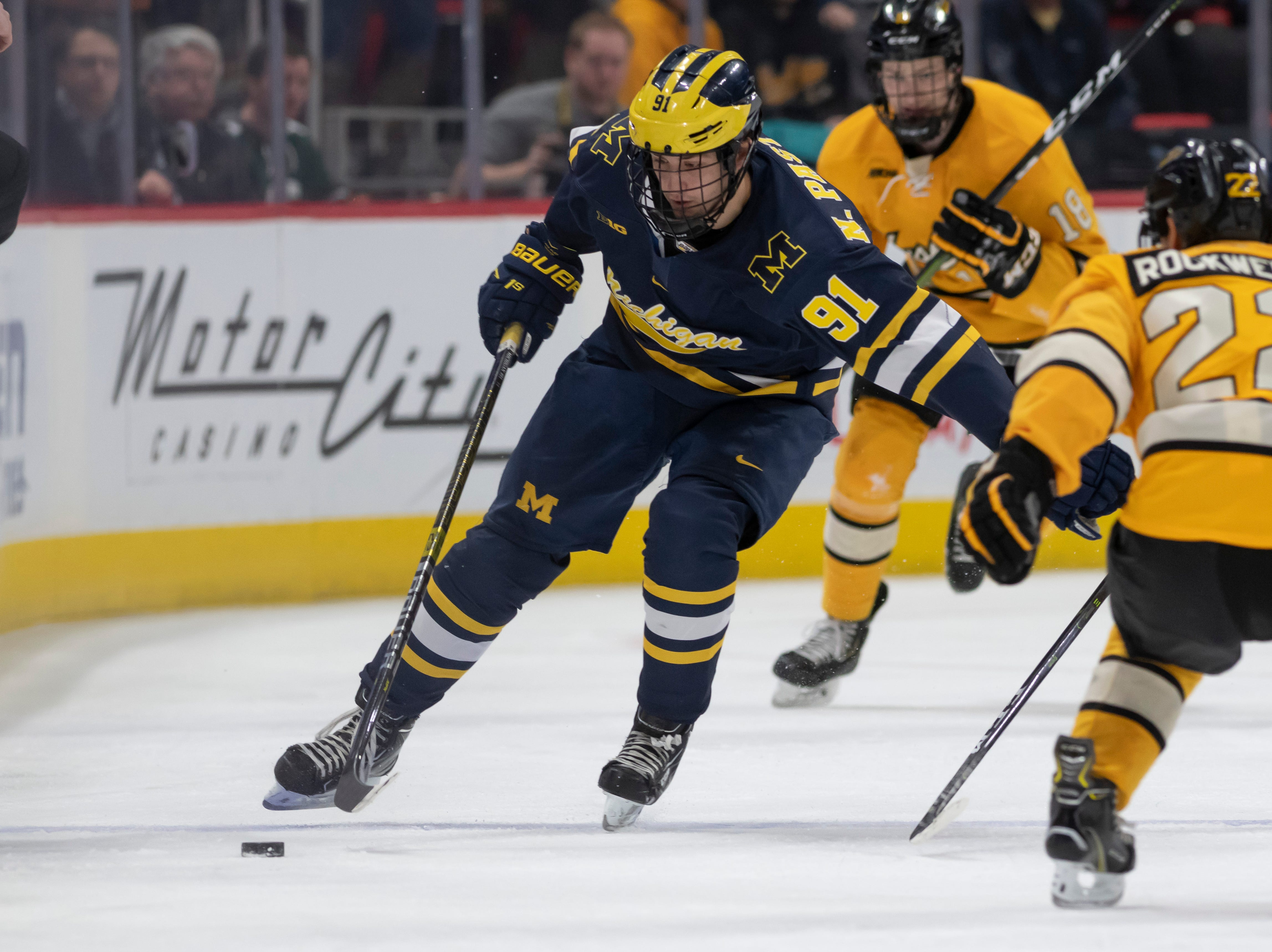 Michigan forward Nick Pastujov moves the puck up the ice in the second period.