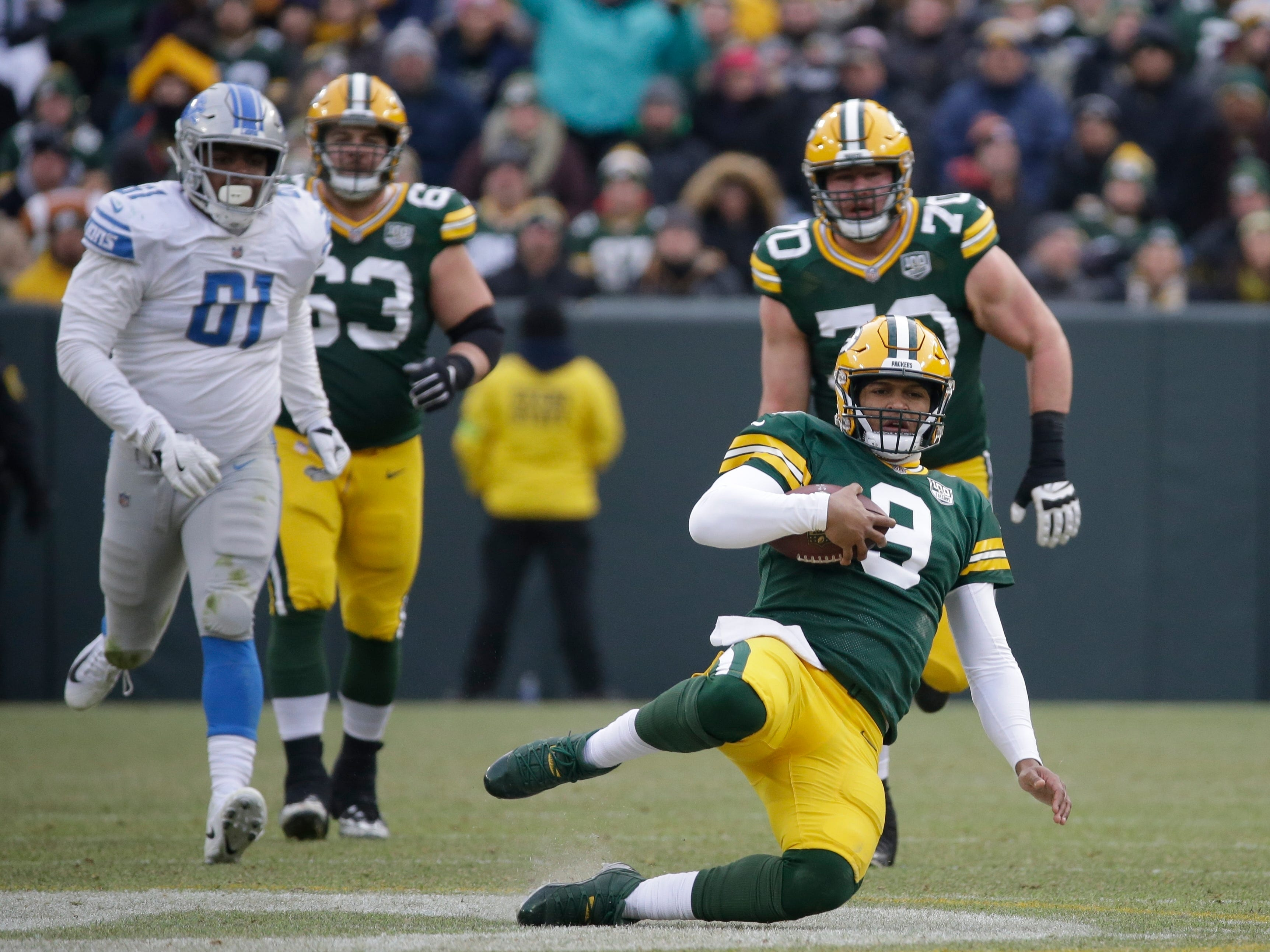 Green Bay's DeShone Kizer slides after running for a first down during the second half.