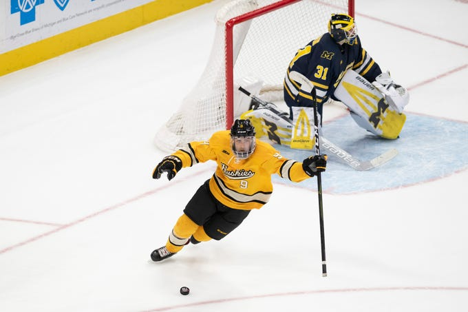 Michigan Tech forward Tommy Parrottino celebrates after scoring the winning goal in the shootout during a 3-2 win over Michigan in the semifinal round of the Great Lakes Invitational at Little Caesars Arena on Sunday, Dec. 30, 2018, in Detroit.