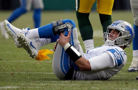 Lions quarterback Matthew Stafford reacts after being hit late by the Packers' Fadol Brown in the second half.