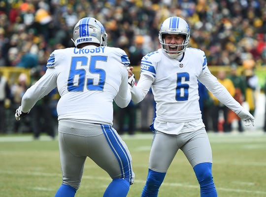 Detroit's Sam Martin celebrates with Tyrell Crosby during the first half.