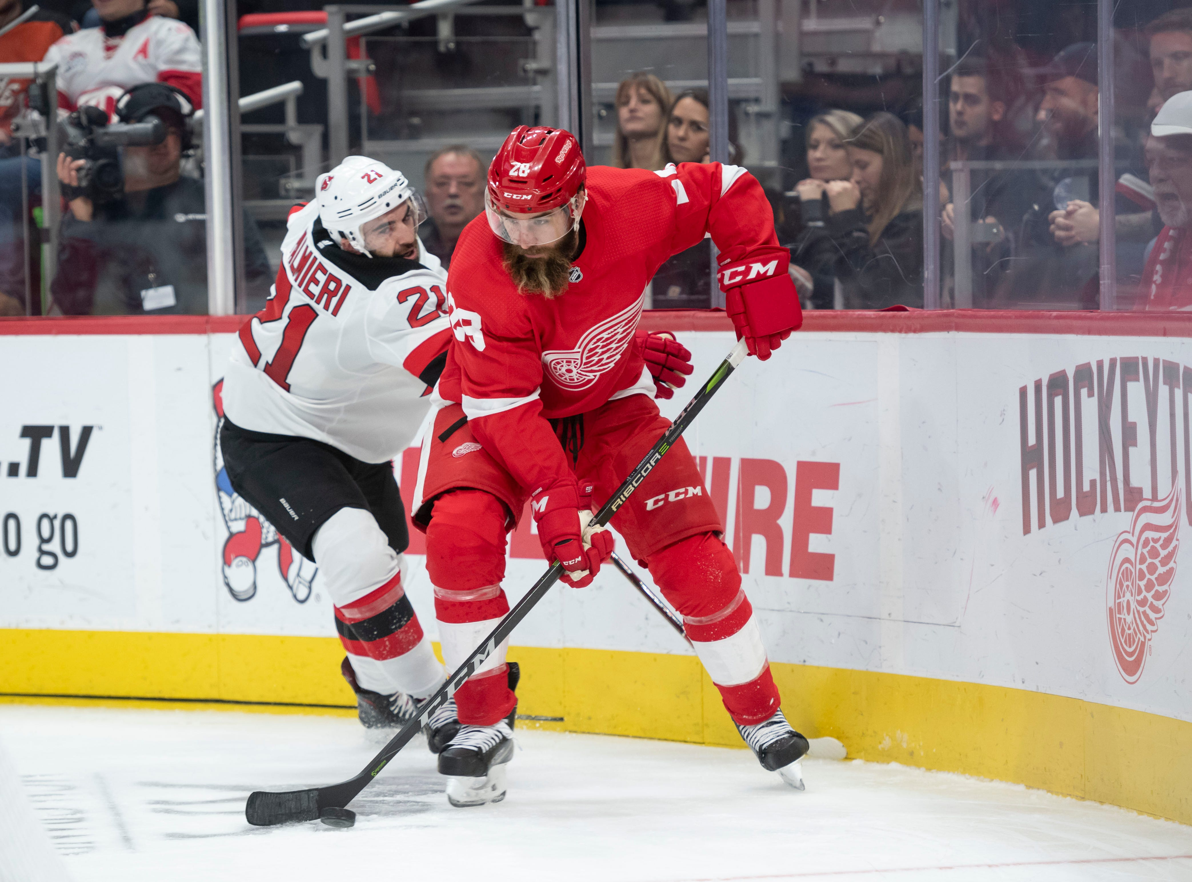 Detroit defenseman Luke Witkowski keeps the puck away from New Jersey right wing Kyle Palmieri            Photos are of the Detroit Red Wings vs. the New Jersey  Devils, at Little Caesars Arena, in Detroit, November 1, 2018.  (David Guralnick / The Detroit News)