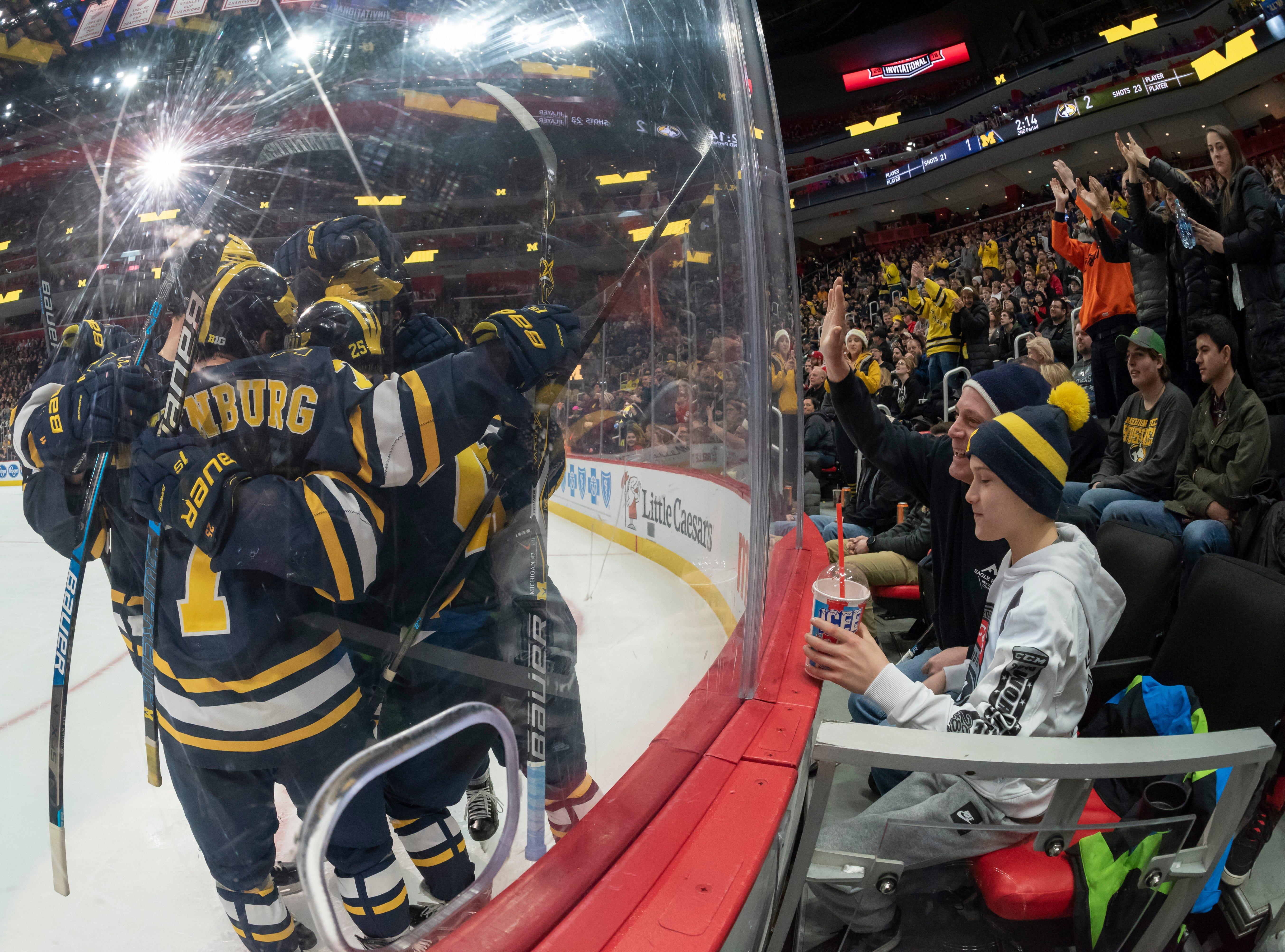 Michigan celebrates after forward Adam Winborg scored in the second period.