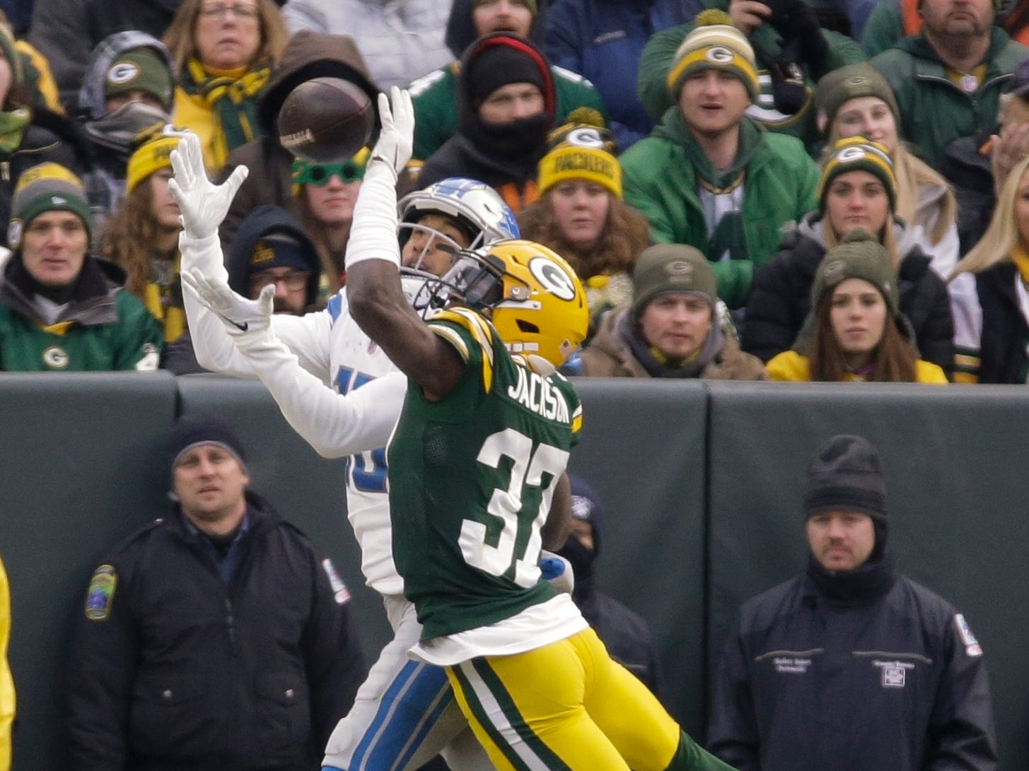 Detroit's T.J. Jones catches a touchdown pass in front of Green Bay's Josh Jackson during the second half.