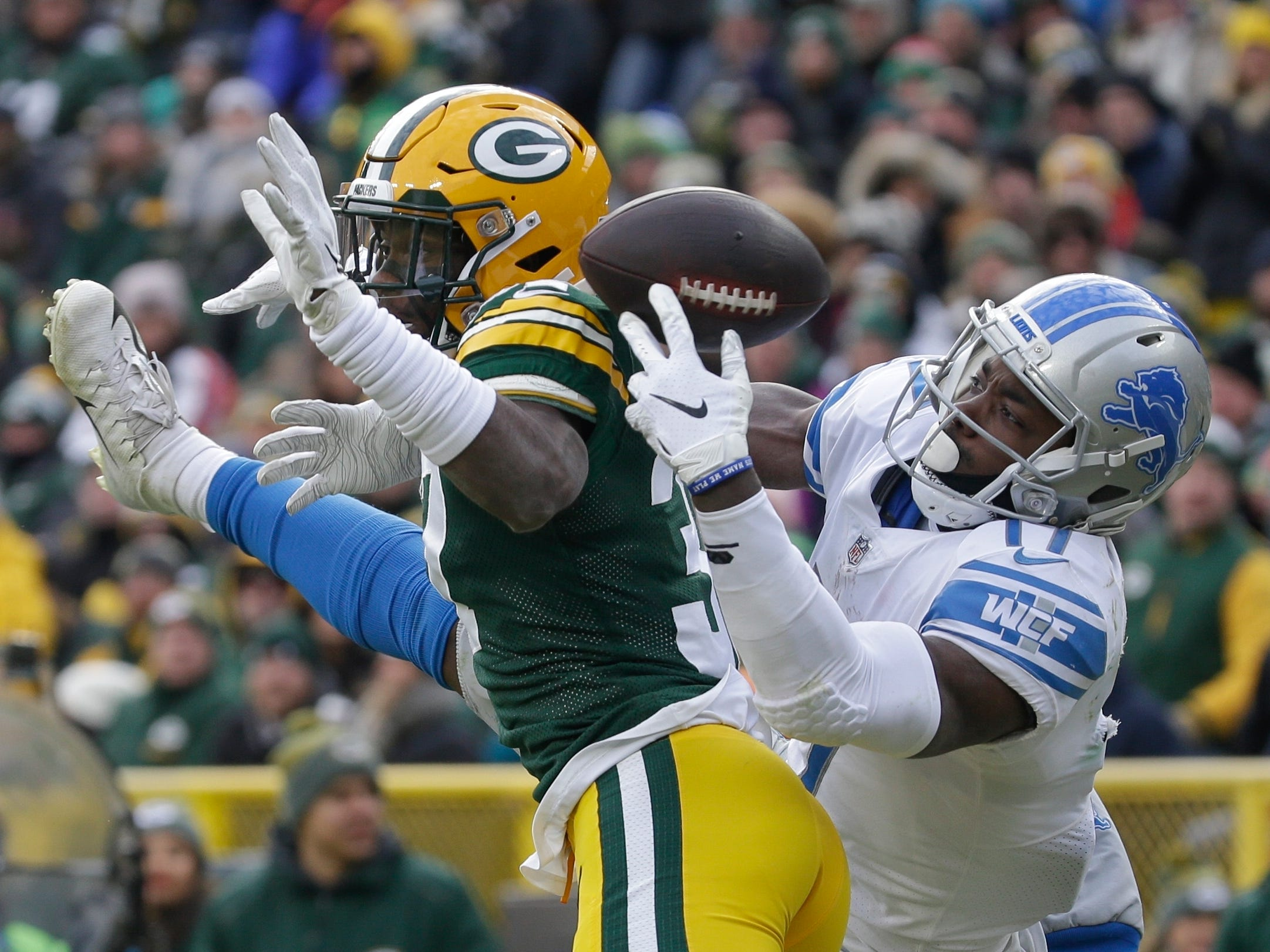 Green Bay's Josh Jackson breaks up a pass intended for Detroit's Andy Jones during the second half Sunday, Dec. 30, 2018, at Lambeau Field in Green Bay, Wis. The Lions won the season finale, 31-0.