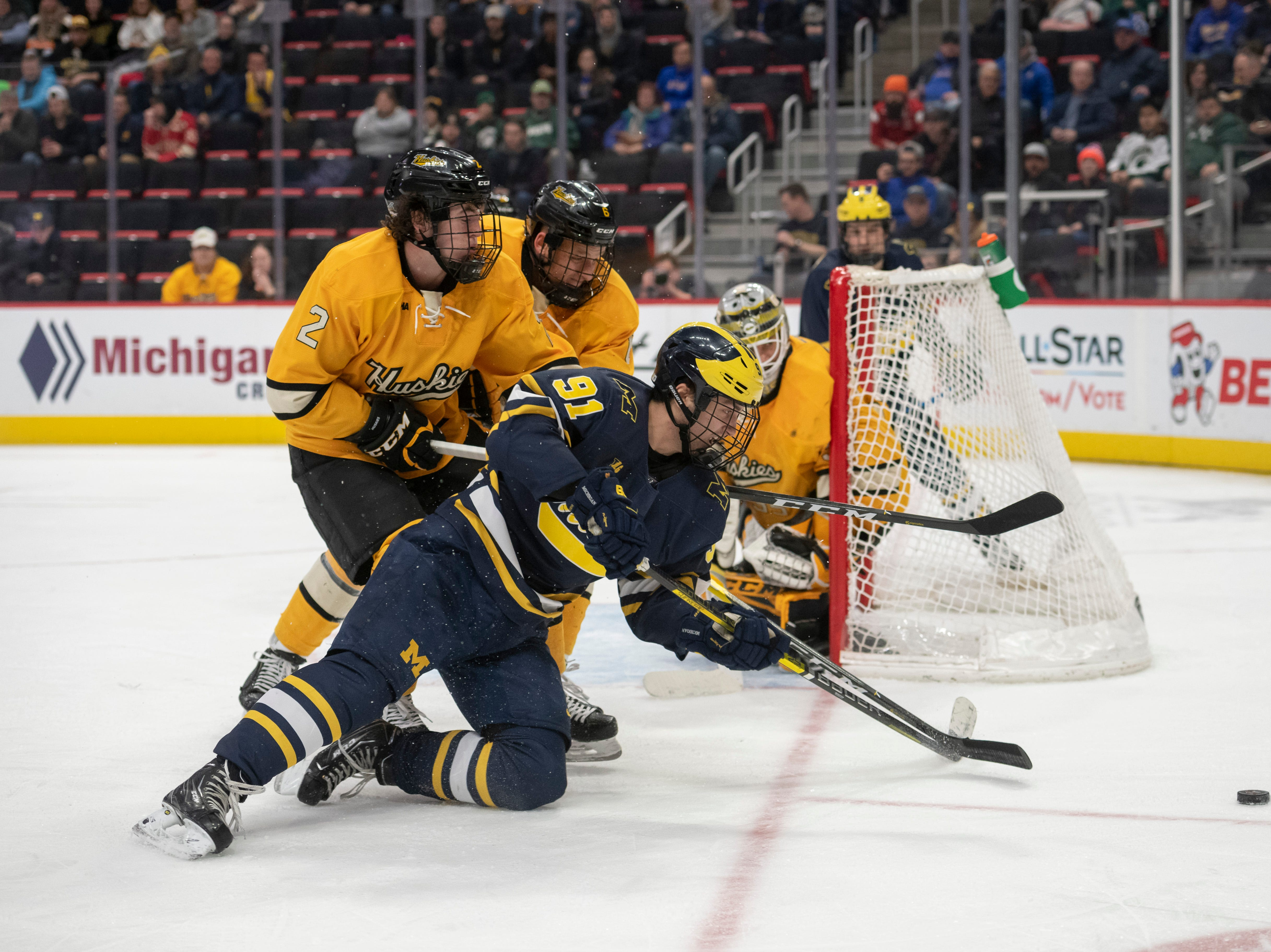 Michigan forward Nick Pastujov tries to get the puck past Michigan Tech's defense in the second period.