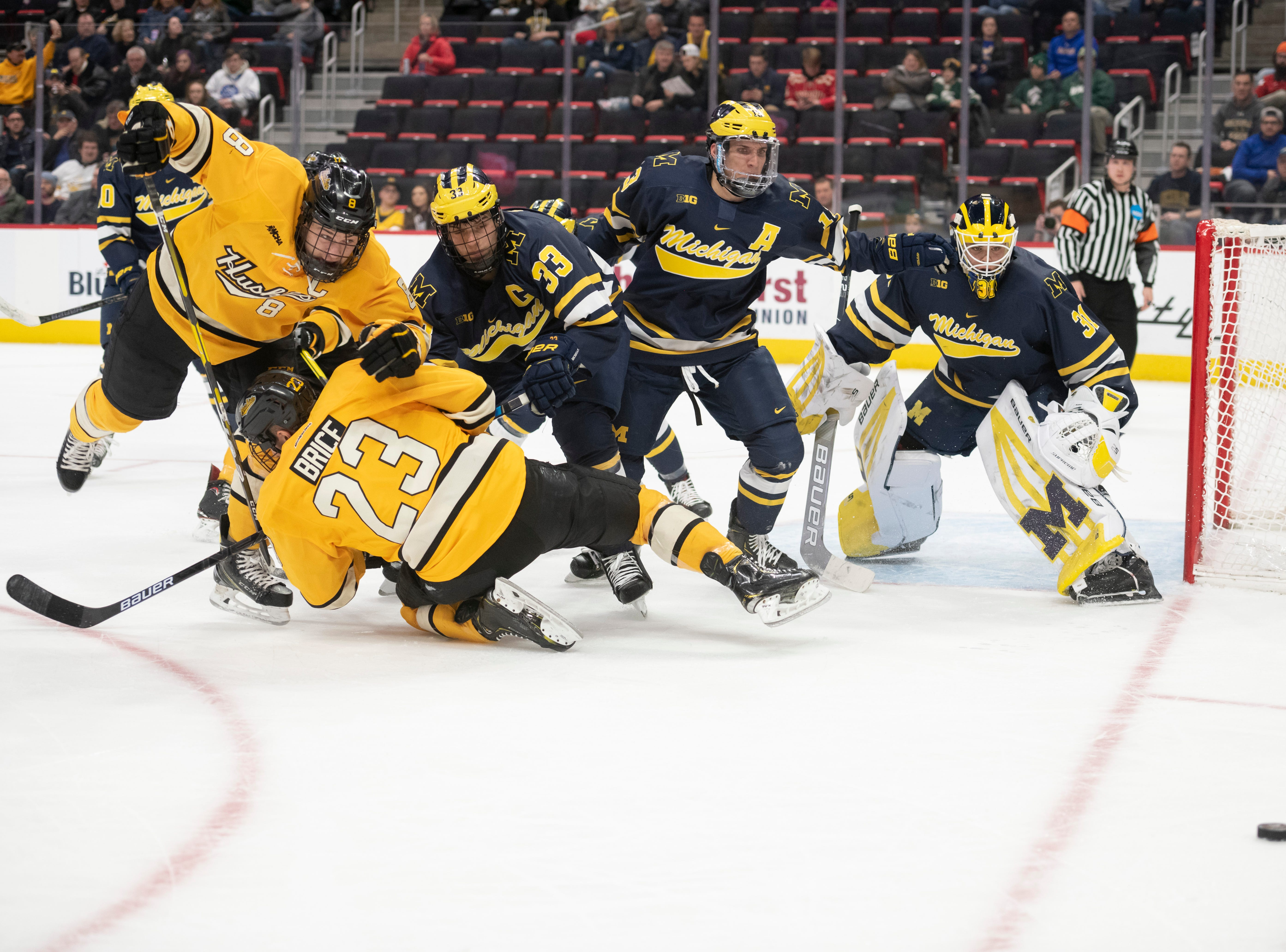 The two teams battle for the puck in front of Michigan's net in the first period.