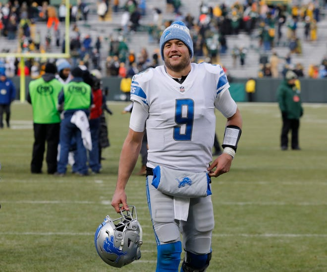 The Detroit Lions' Matthew Stafford smiles as he walks off the field after the win over Green Bay.