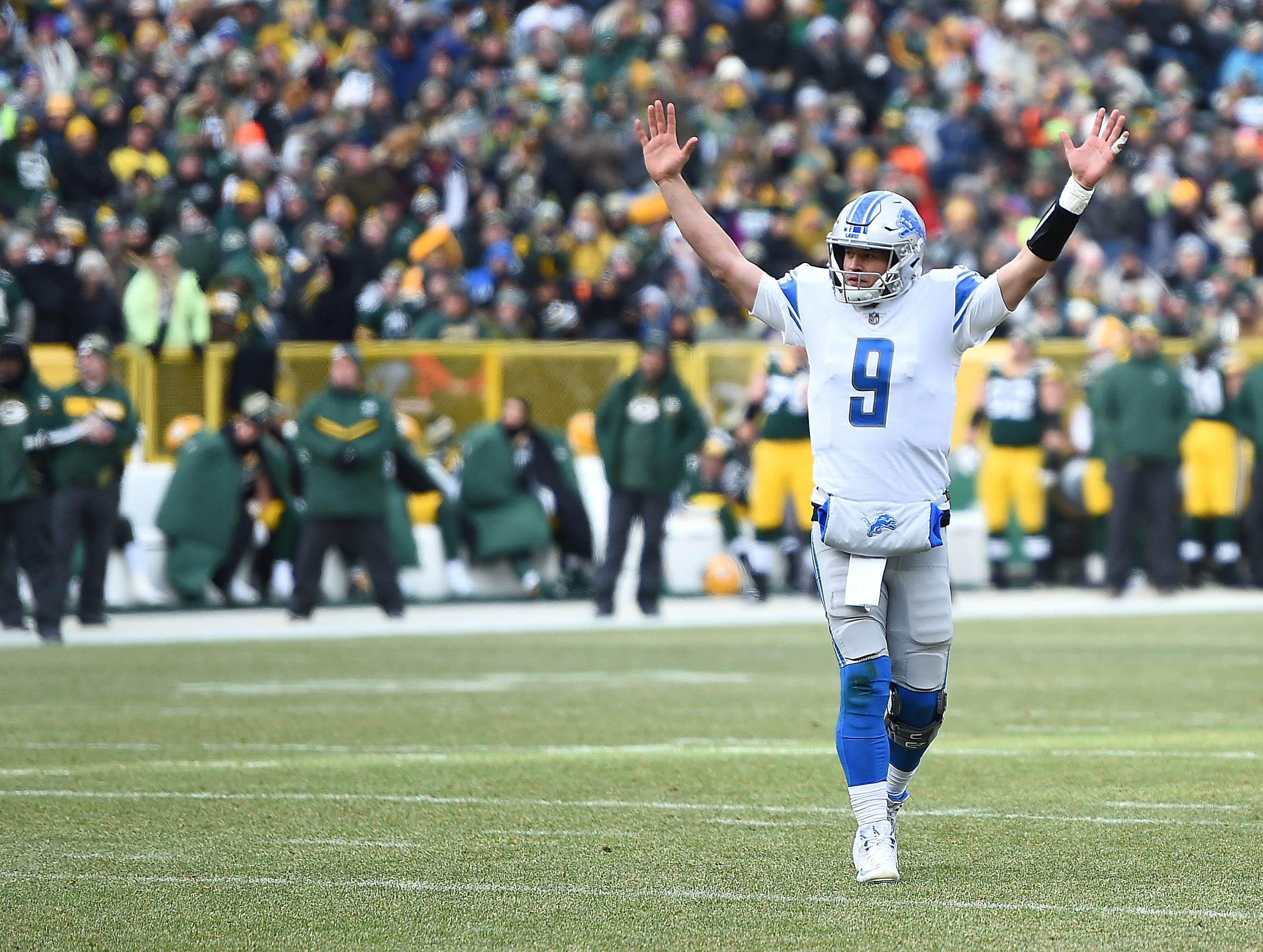 Lions quarterback Matthew Stafford  reacts during the first half.