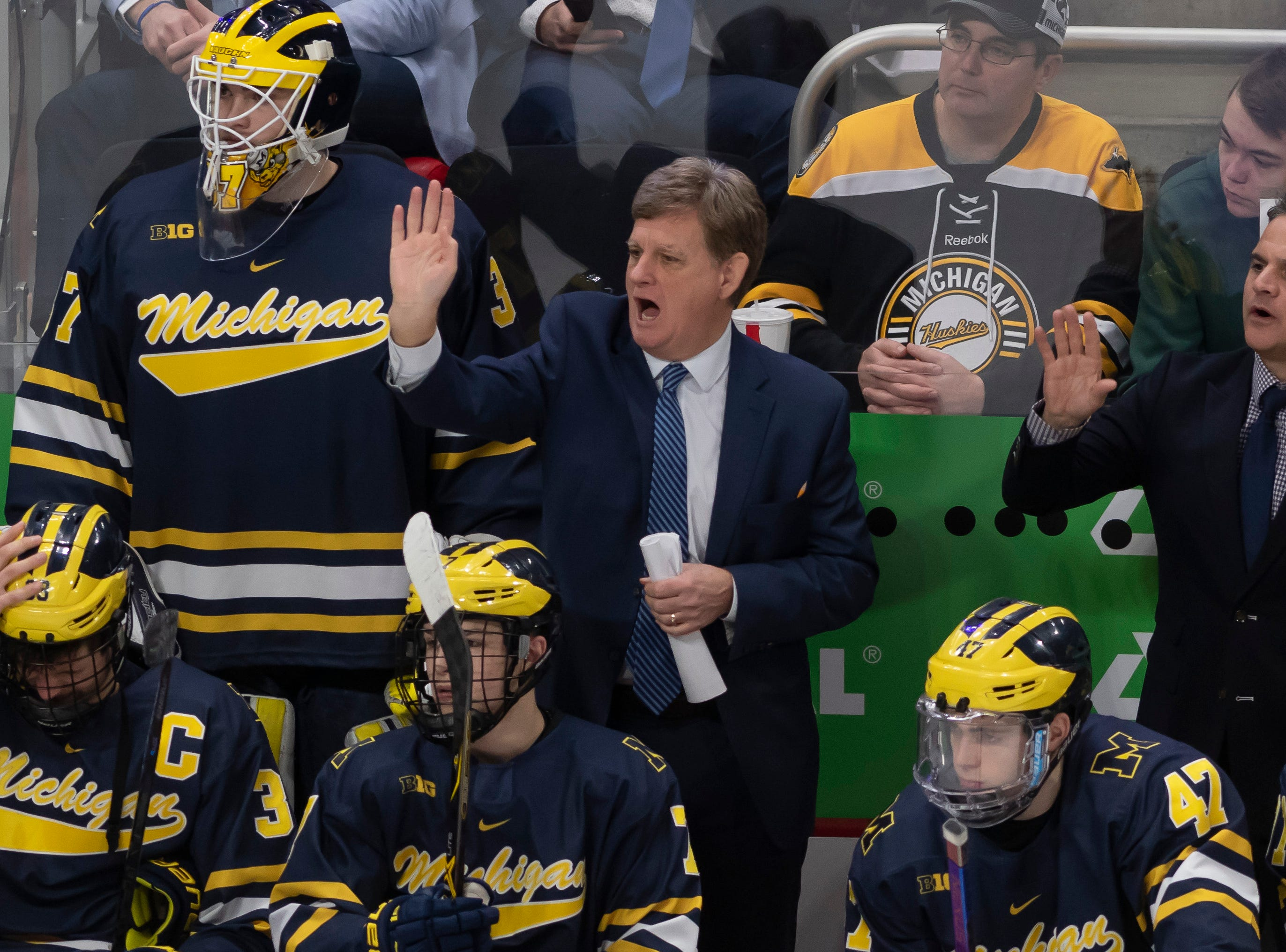 Michigan head coach Mel Pearson directs his players in the third period.