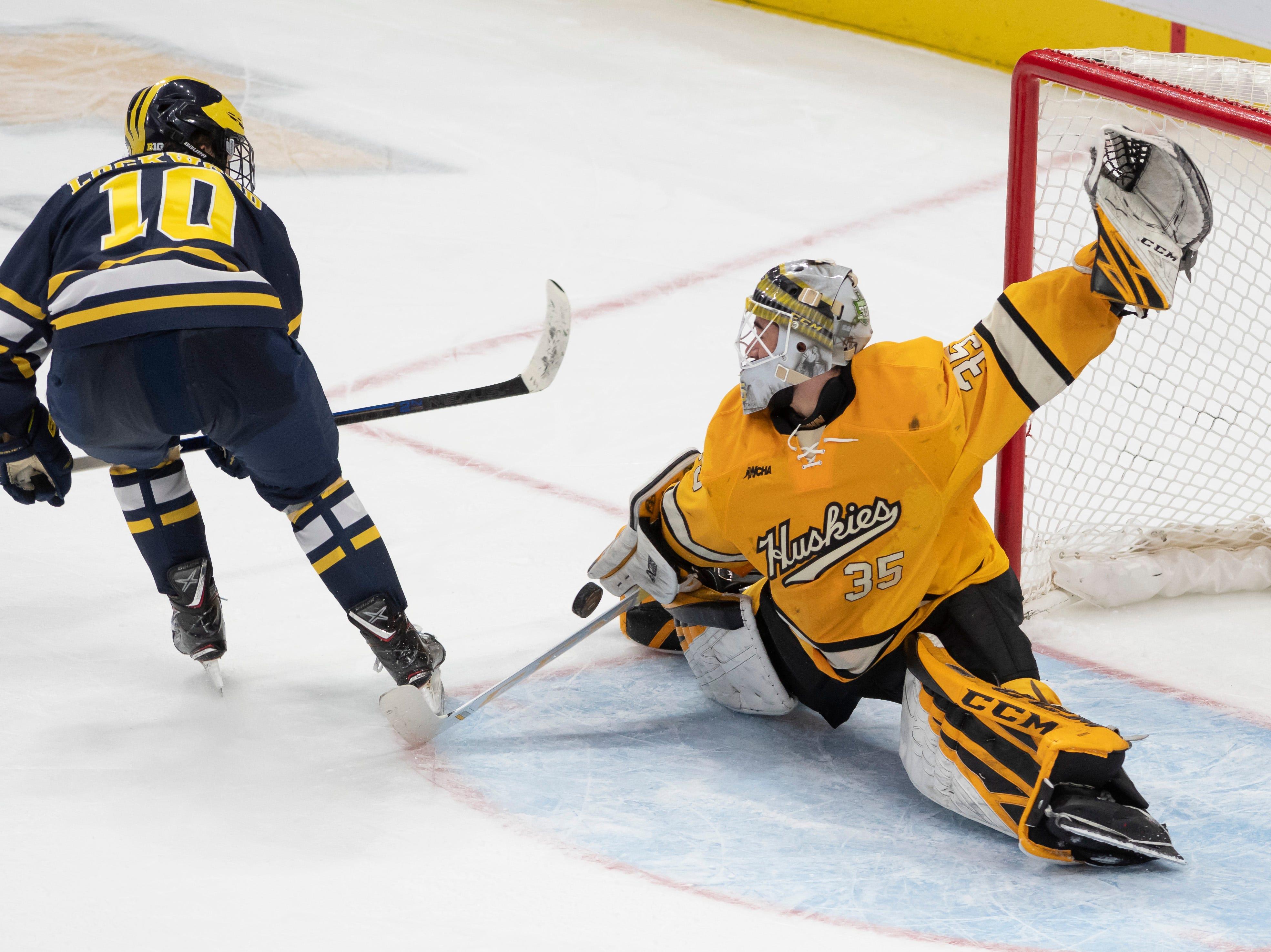 Michigan forward Will Lockwood fails to score on Michigan Tech goaltender Robbie Beydoun during a breakaway in the third period.