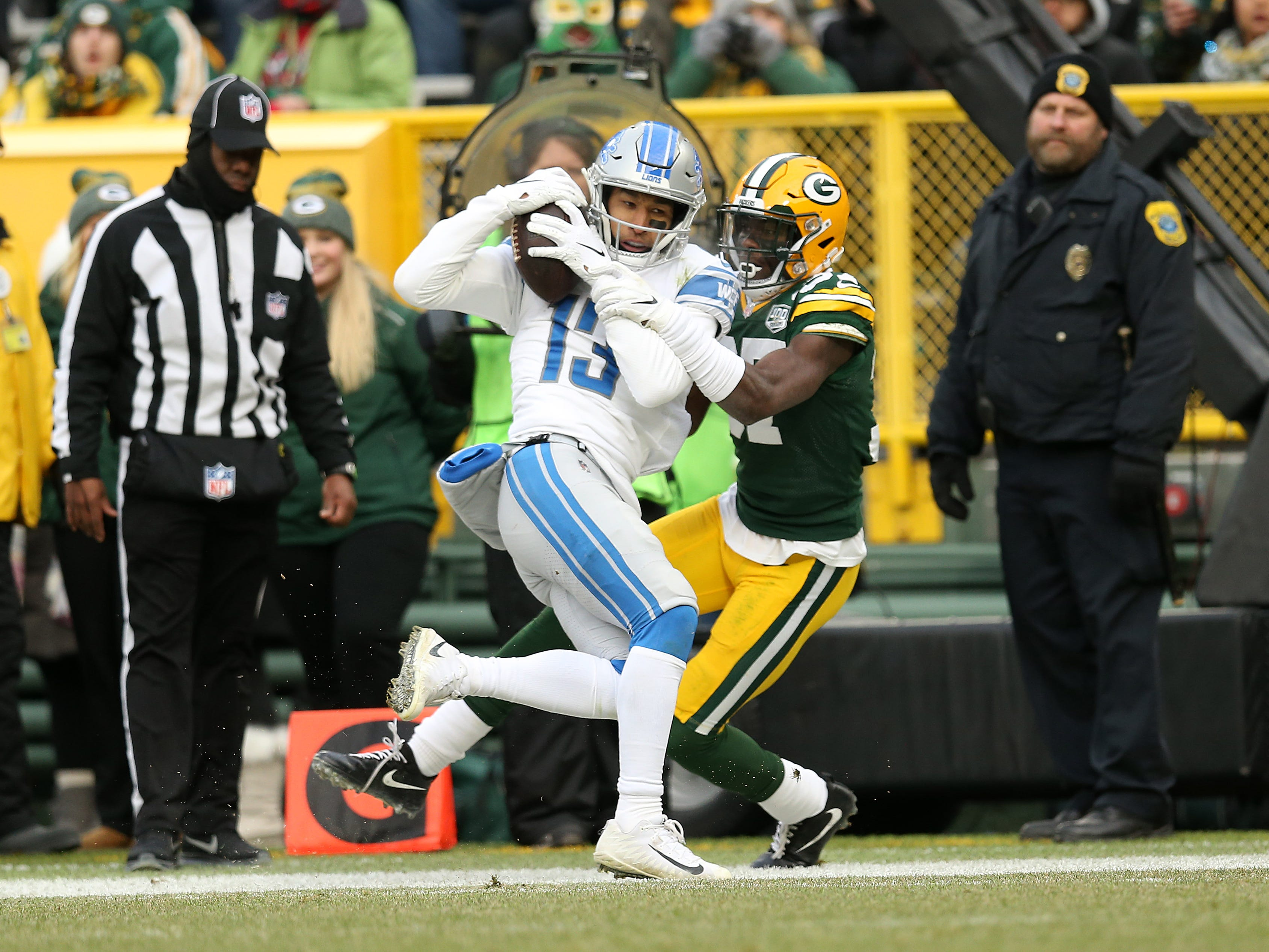 Detroit's T.J. Jones catches a pass for a touchdown against Green Bay's  Josh Jackson during the second half.