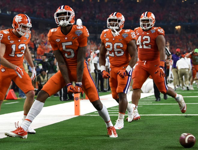 Clemson wide receiver Tee Higgins (5) celebrates his touchdown catch with wide receiver Hunter Renfrow (13), running back Adam Choice (26) and linebacker John Boyd (46) in the first half.