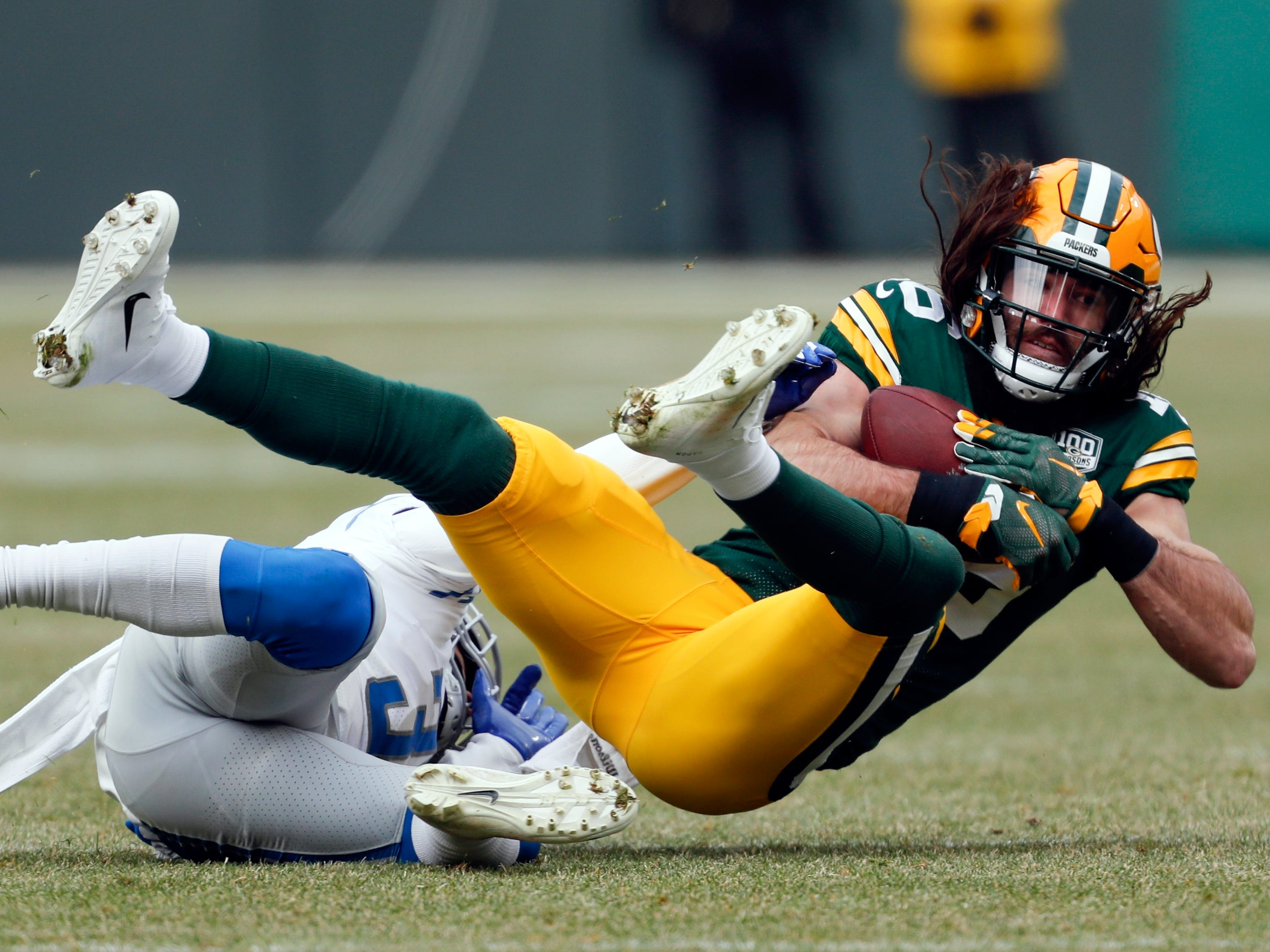 Detroit's Mike Ford tackles Green Bay's Jake Kumerow during the first half.