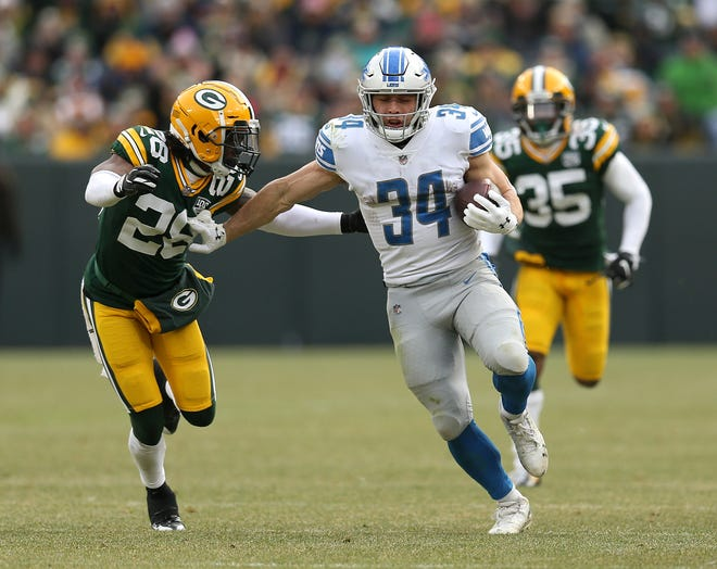 Zach Zenner of the Detroit Lions runs against Tony Brown of the Green Bay Packers during the second half.