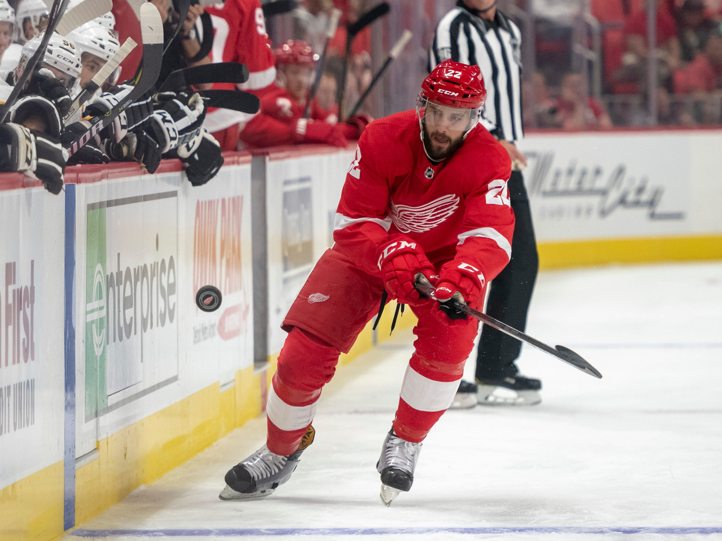 Detroit defenseman Wade Megan tries to stop a bouncing puck during the first period.            Photos are of the Detroit Red Wings vs. the Pittsburgh Penguins during a preseason game at Little Caesars Arena, in Detroit, September 19, 2018.  (David Guralnick / The Detroit News)