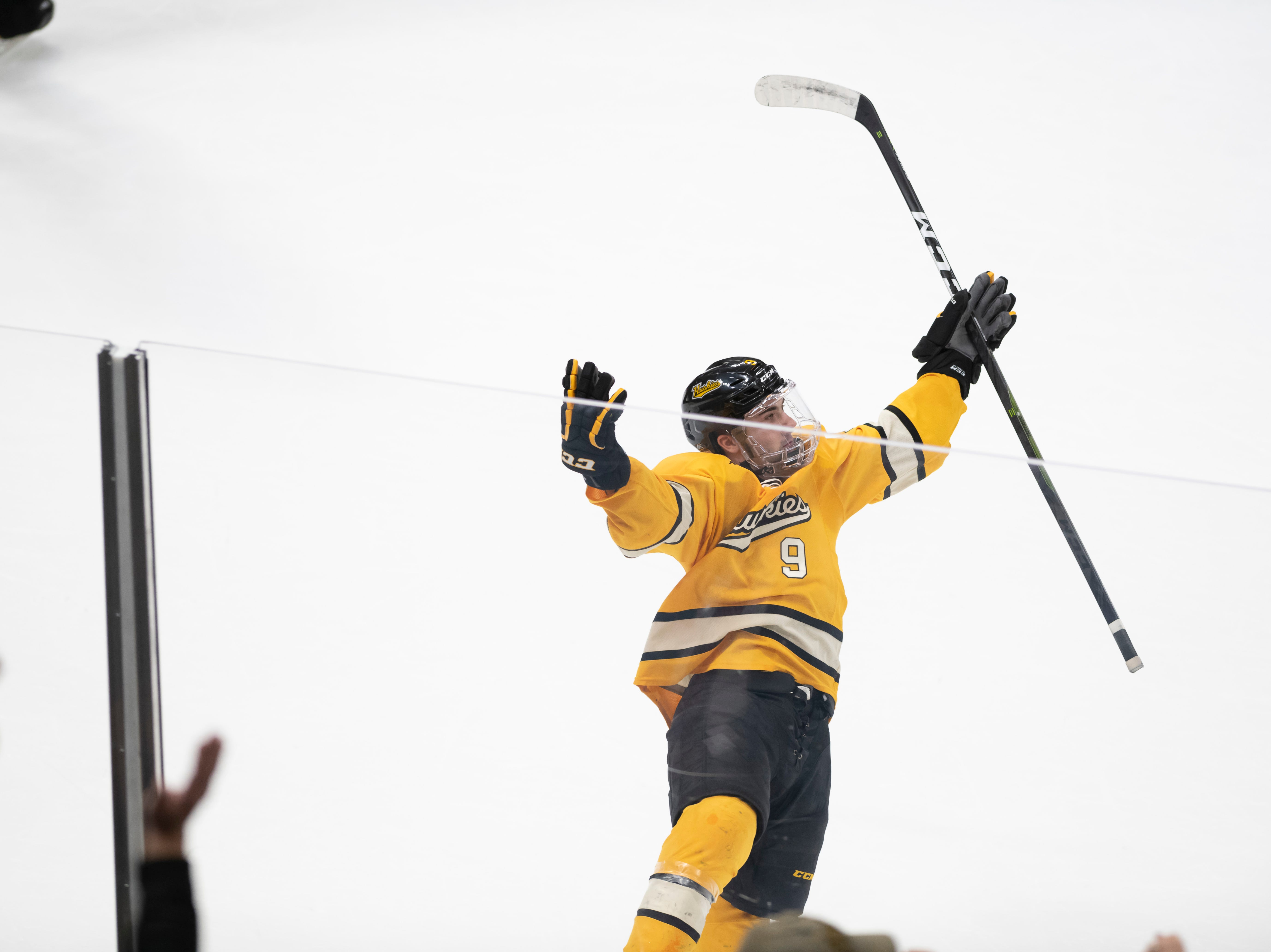 Michigan Tech forward Tommy Parrottino celebrates after scoring the winning goal in the shootout.