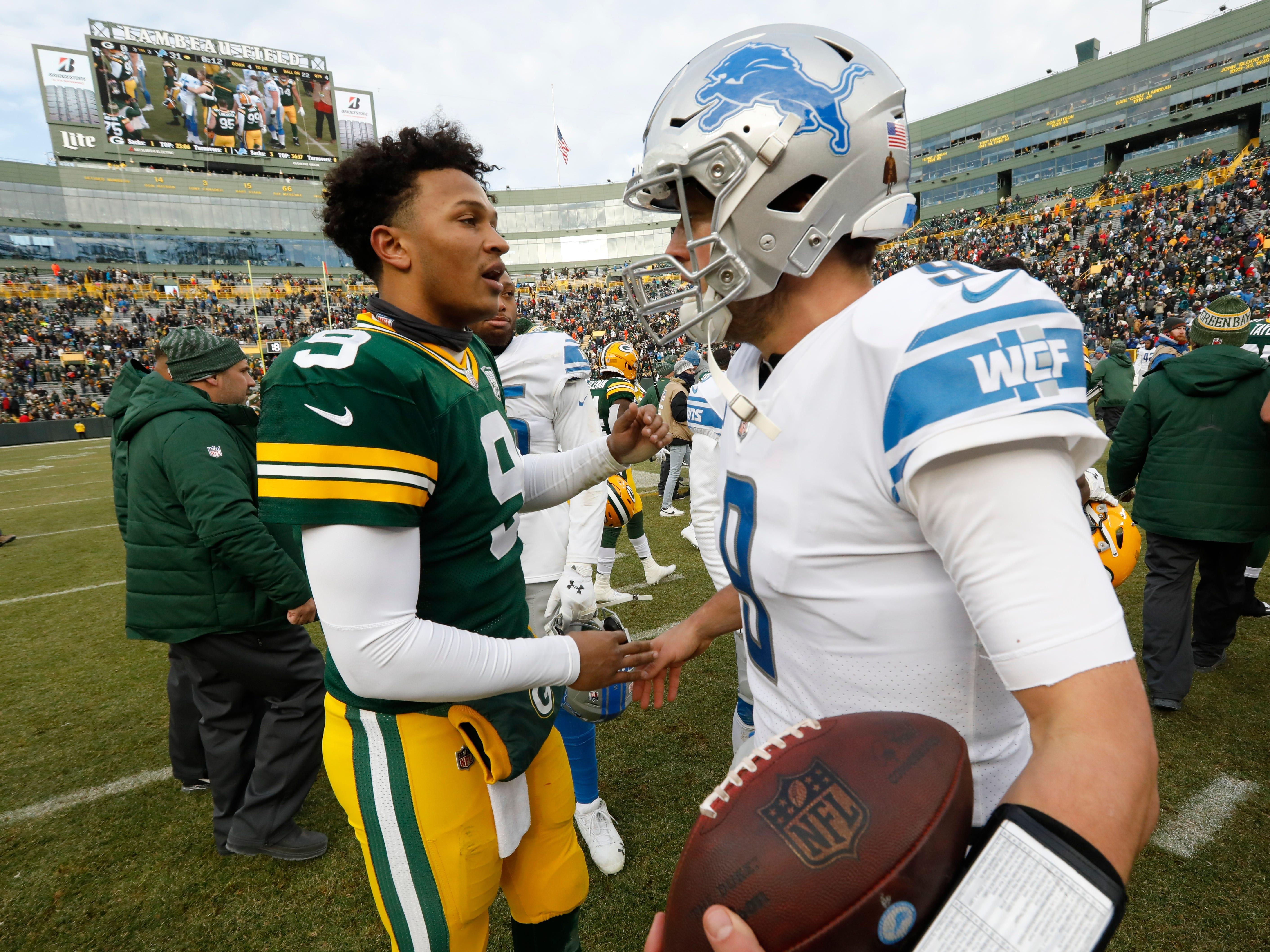Packers quarterback DeShone Kizer talks to Lions quarterback Matthew Stafford after the game.