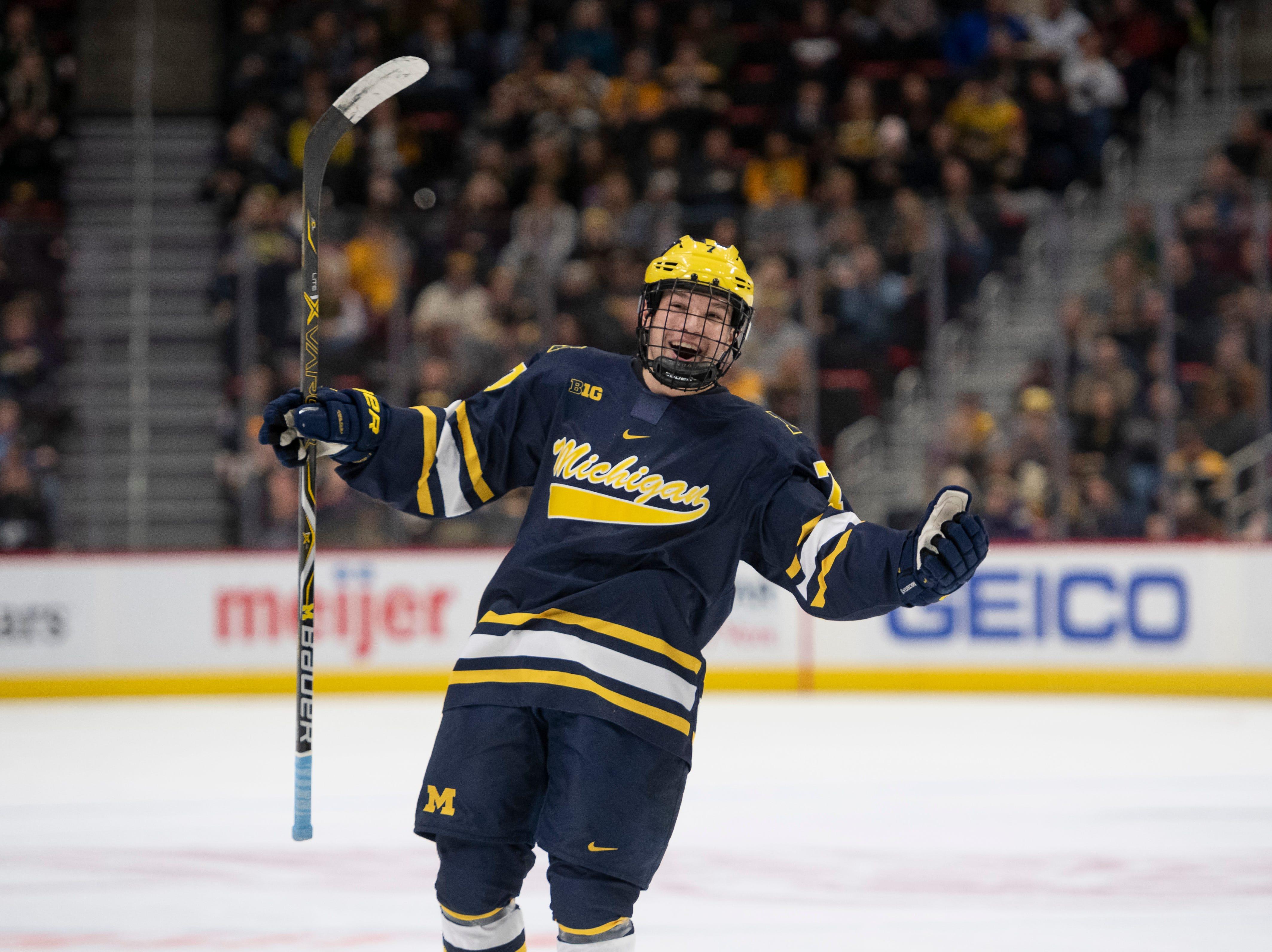 Michigan defenseman Nick Blankenburg celebrates after teammate Adam Winborg scored in the second period.
