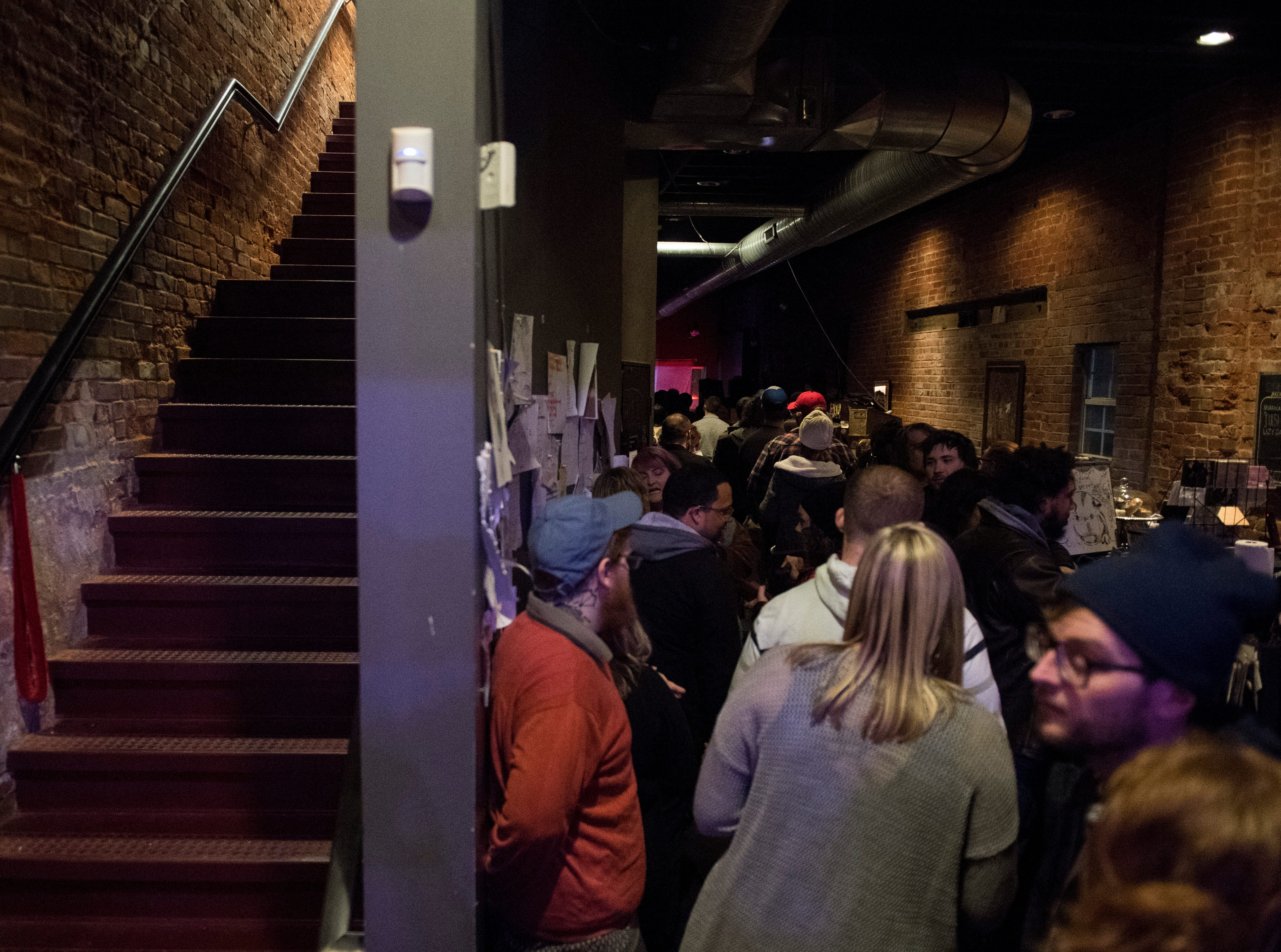 The crowd fills the room during the Farewell Weekend show at PG. PG -- a cafe, art and music venue -- opened March 15, 2013, and has served as a gathering place for the creative community in Evansville. Their final day open is Monday, Dec. 31, 2018.