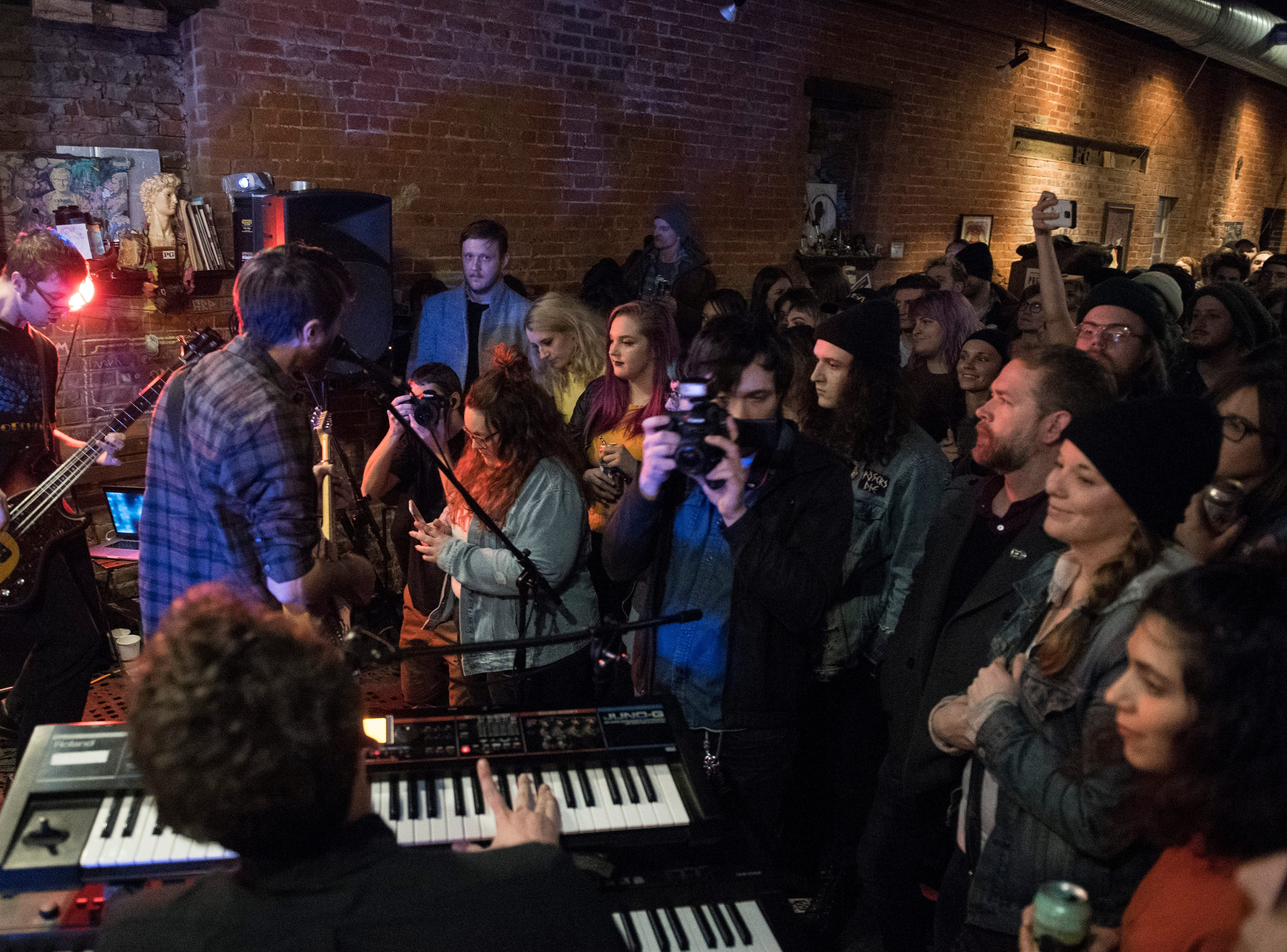 People pack the room at PG as Thunder Dreamer plays during the Farewell Weekend show Saturday, Dec. 29, 2018. PG -- a cafe, art and music venue -- opened March 15, 2013, and has served as a gathering place for the creative community in Evansville. Their final day open is Monday, Dec. 31, 2018.