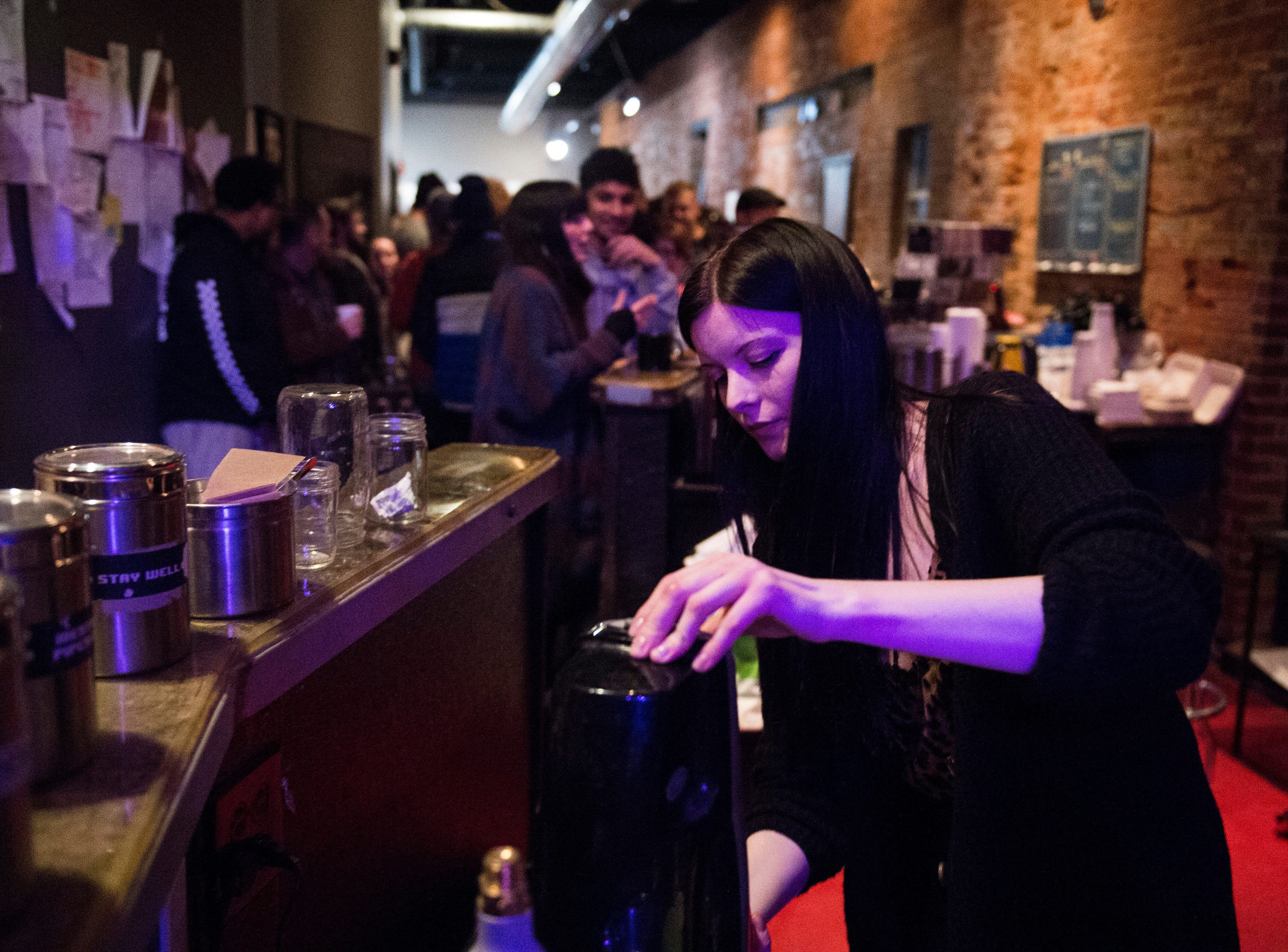 Rachel Terry works her last night behind the counter as she makes a cherry soda during PG's Farewell Weekend show Saturday, Dec. 29, 2018.