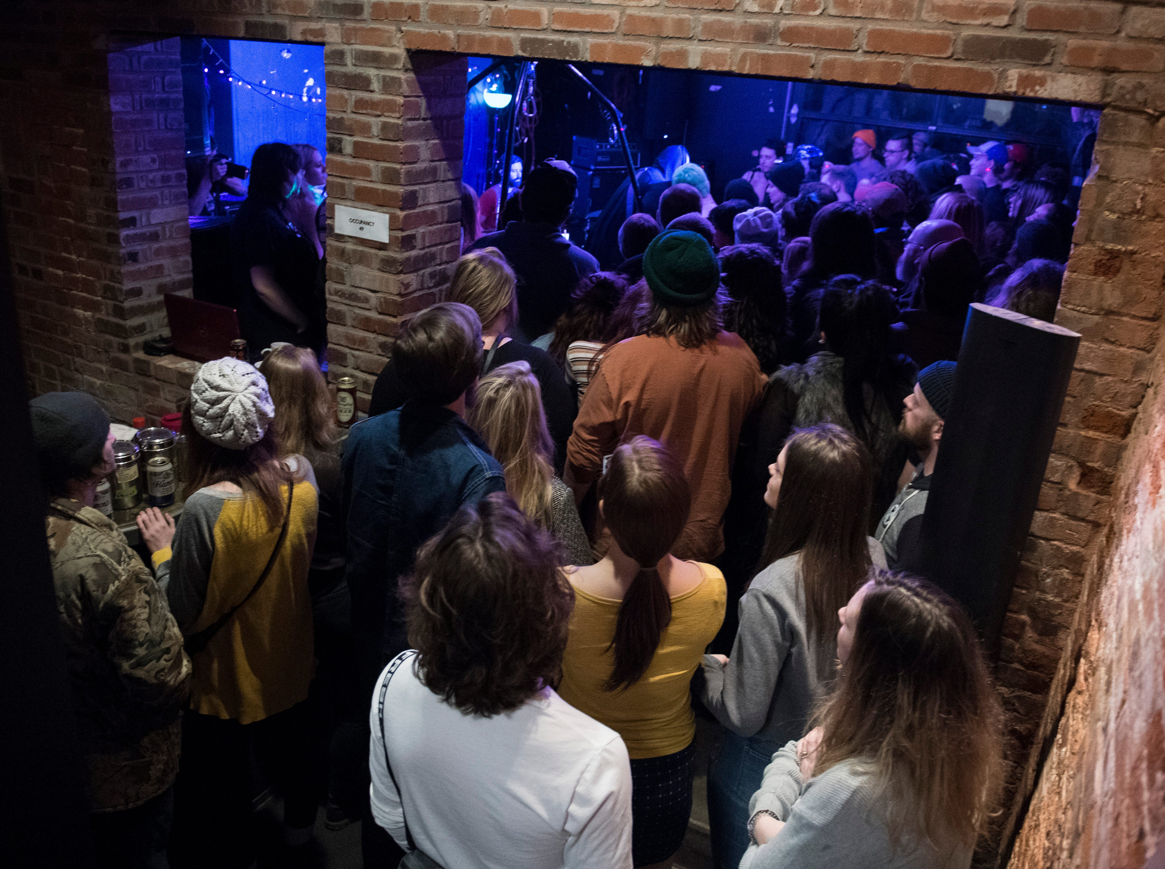 People pack the back room during the Farewell PG Weekend show Saturday, Dec. 29, 2018. PG -- a cafe, art and music venue -- opened March 15, 2013, and has served as a gathering place for the creative community in Evansville. Their final day open is Monday, Dec. 31, 2018.