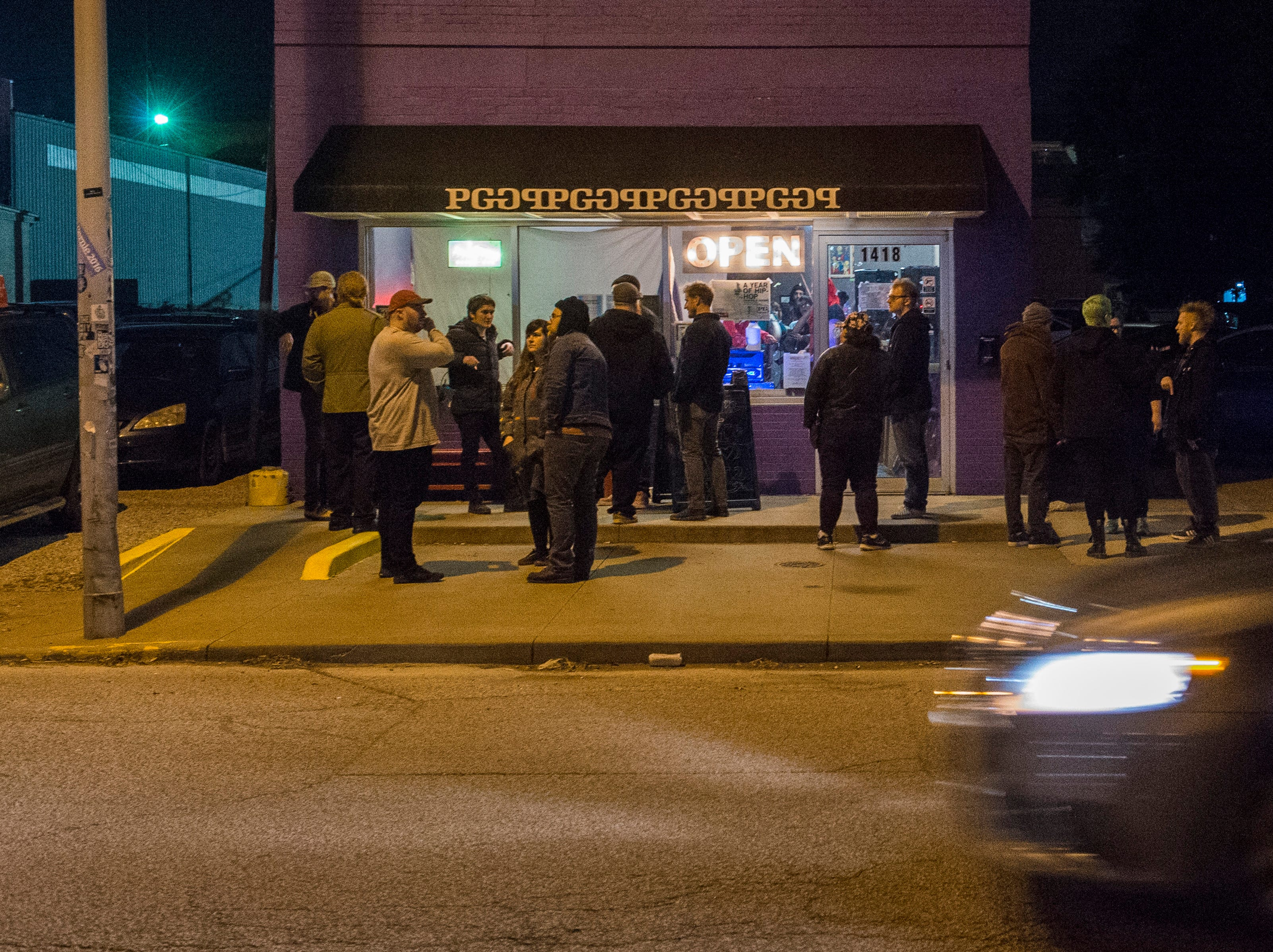 People stand outside between bands during PG's Farewell Weekend show Saturday, Dec. 29, 2018. PG, a cafe, art and music venue, opened March 15, 2013 and has served as a gathering place for the creative community in Evansville. Their final day open is Monday, Dec. 31, 2018.