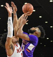 University of Evansville junior guard K.J. Riley goes up for a shot against Miami's Jalen Adaway on Sunday afternoon at Millett Hall in Oxford, Ohio.