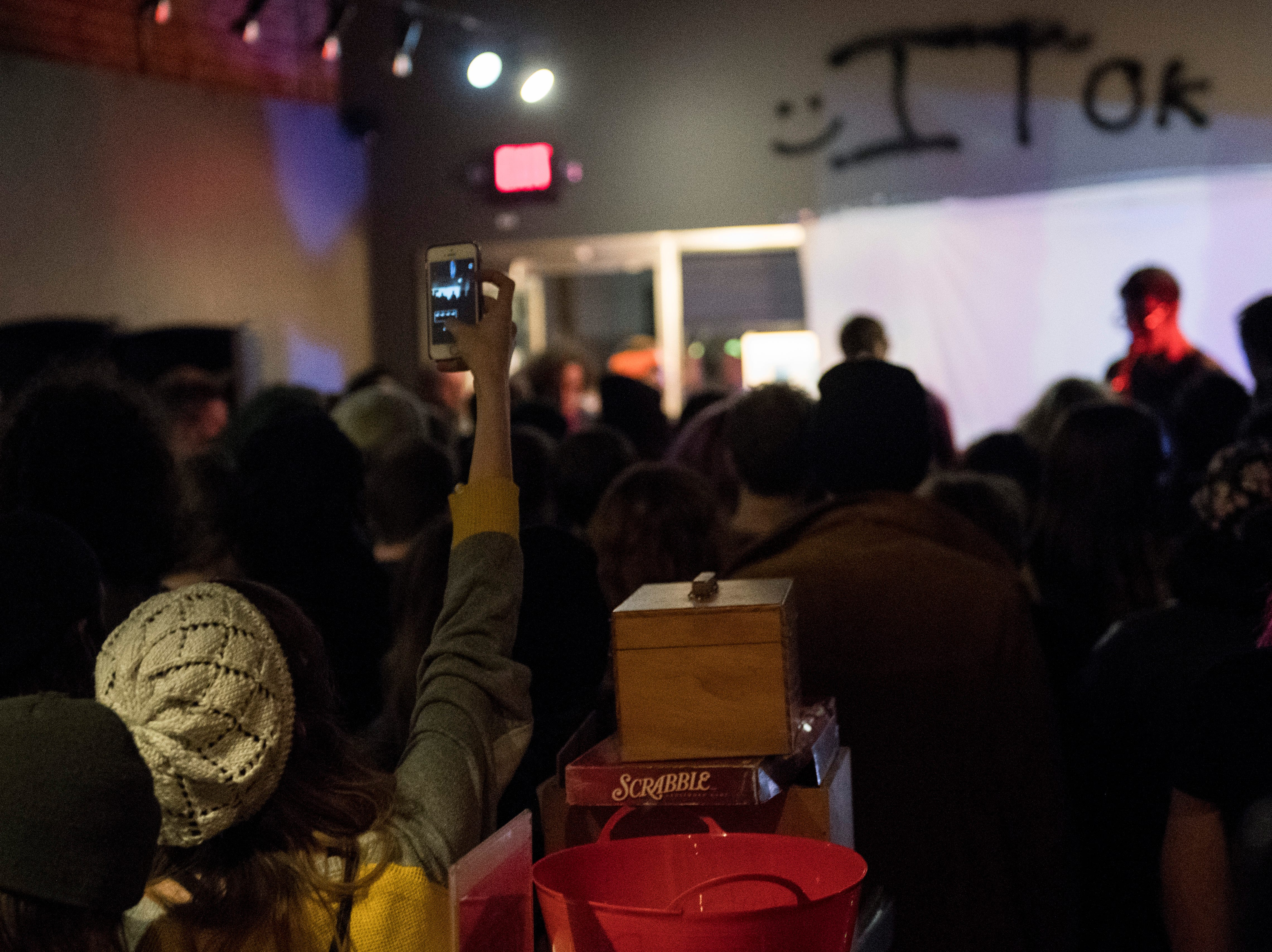 A listener takes video of Thunder Dreamer during their set of the Farewell Weekend show at PG Saturday, Dec. 29, 2018. PG -- a cafe, art and music venue -- opened March 15, 2013, and has served as a gathering place for the creative community in Evansville. Their final day open is Monday, Dec. 31, 2018.