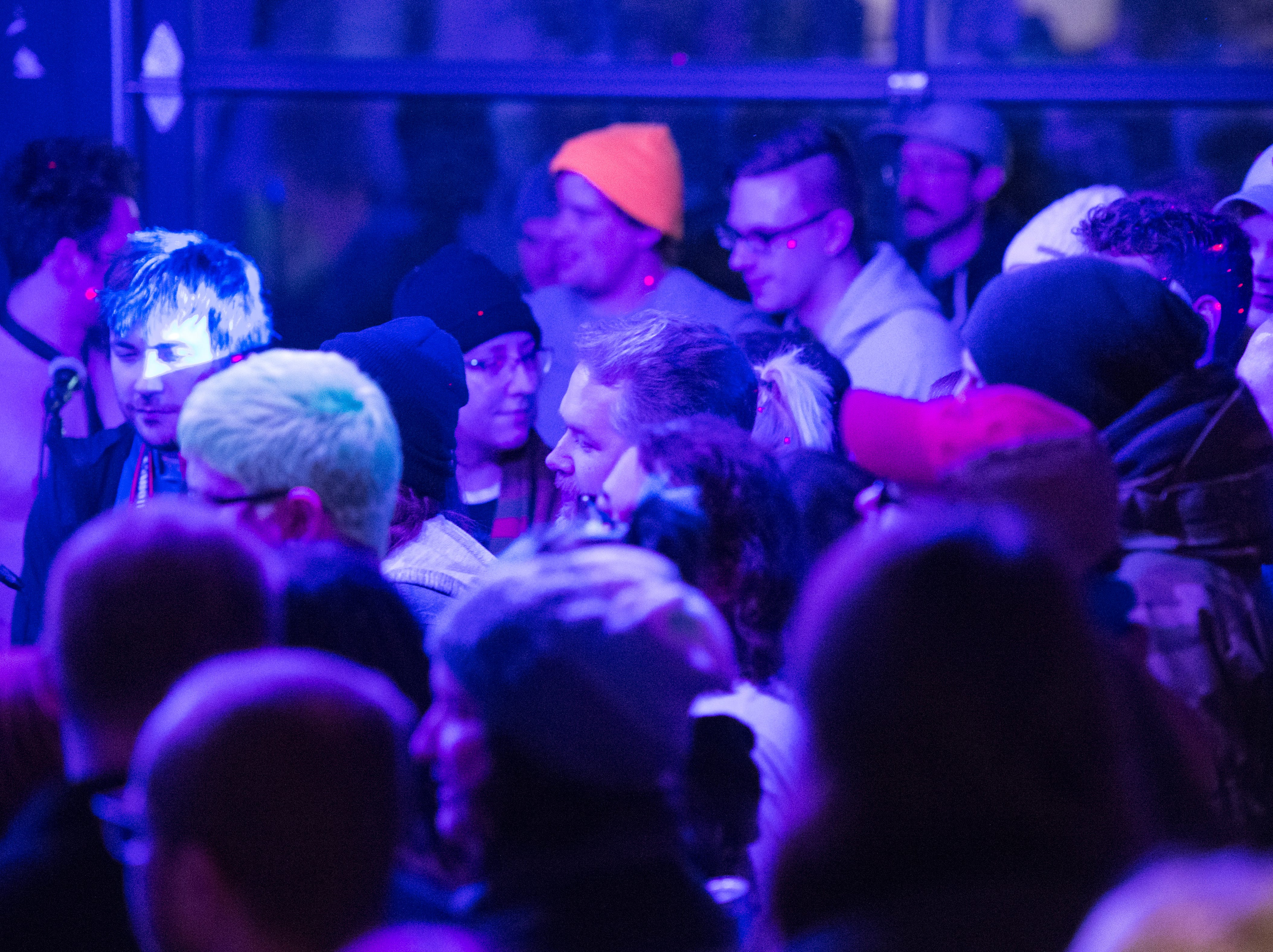 """People pack the back room during the Farewell PG Weekend show Saturday, Dec. 29, 2018. PG -- a cafe, art and music venue -- opened March 15, 2013, and has served as a gathering place for the creative community in Evansville. """"We always survive,"""" said owner Todd Elkshow Huber. Their final day open is Monday, Dec. 31, 2018."""