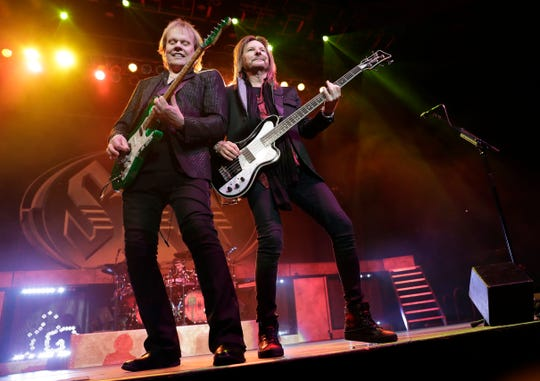 Styx band members James Young and Ricky Phillips perform Dec. 29, 2018, at the Resch Center in Ashwaubenon, Wis.