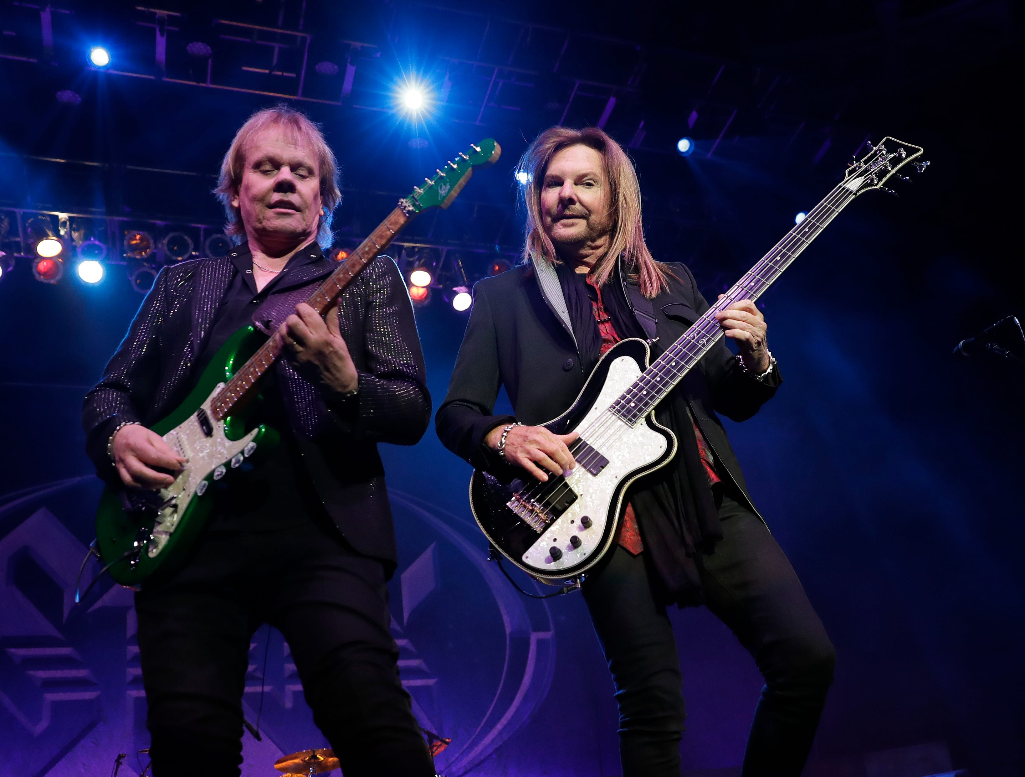 Styx band members James Young and Ricky Phillips perform Dec. 29, 2018 at the Resch Center in Ashwaubenon, Wis.
