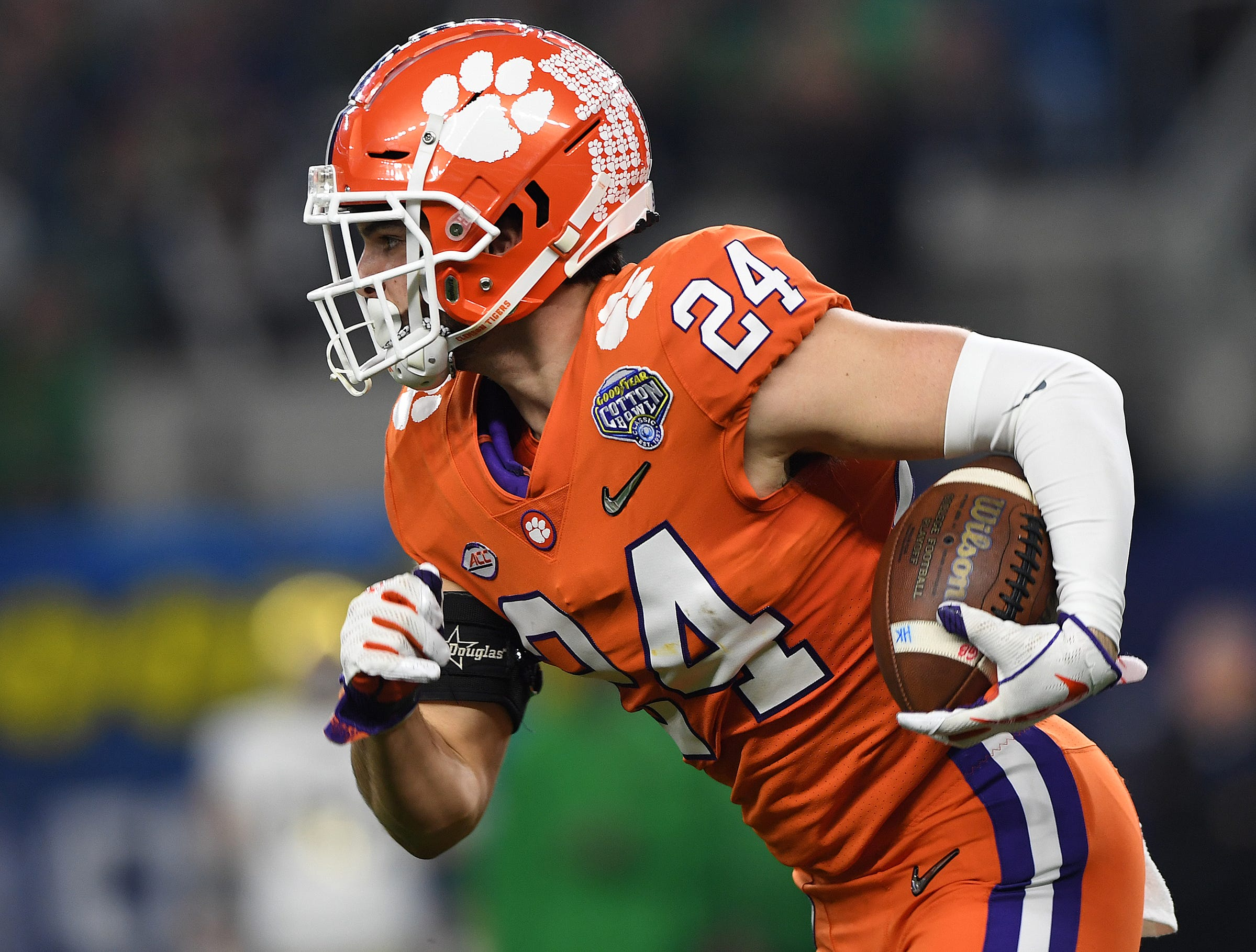 Clemson safety Nolan Turner (24) returns a interception against Notre Dame during the 3rd quarter of the Goodyear Cotton Bowl at AT&T stadium in Arlington, TX Saturday, December 29, 2018.