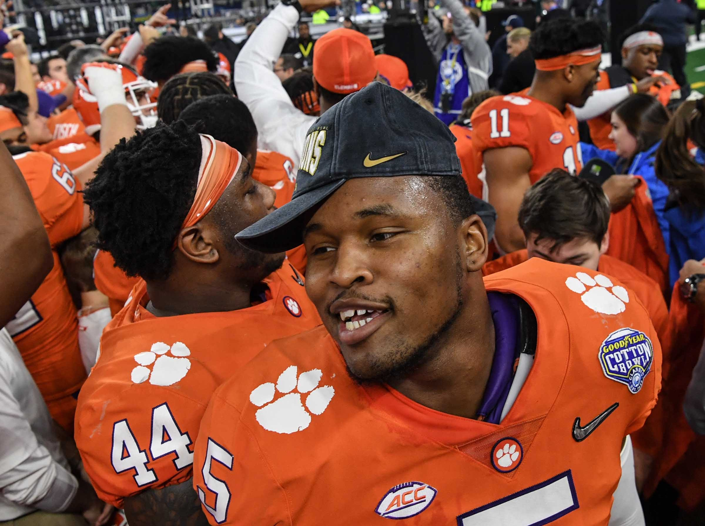 Clemson linebacker Shaq Smith (5) celebrates with teammates after a 30-3 win over Notre Dame in the College Football Playoff Semifinal at the Goodyear Cotton Bowl Classic at AT&T Stadium in Arlington, Texas Saturday, December 29, 2018.