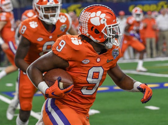 Clemson running back Travis Etienne (9) runs against Notre Dame during the second quarter of the College Football Playoff Semifinal at the Goodyear Cotton Bowl Classic at AT&T Stadium in Arlington, Texas Saturday, December 29, 2018.