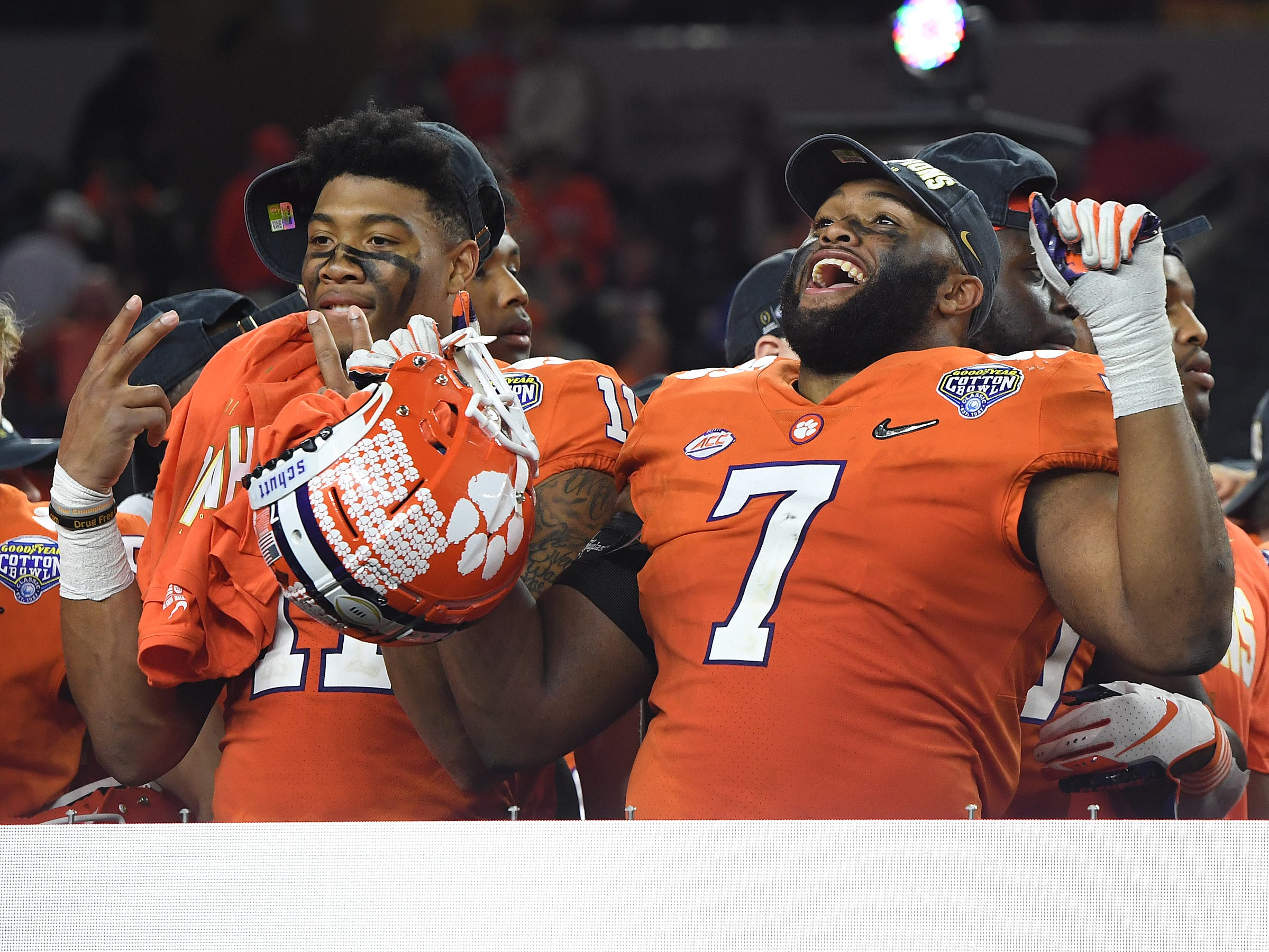 Clemson safety Isaiah Simmons (11), left, and defensive lineman Austin Bryant (7) celebrate the Tigers 30-3 win over Notre Dame in the Goodyear Cotton Bowl at AT&T stadium in Arlington, TX Saturday, December 29, 2018.