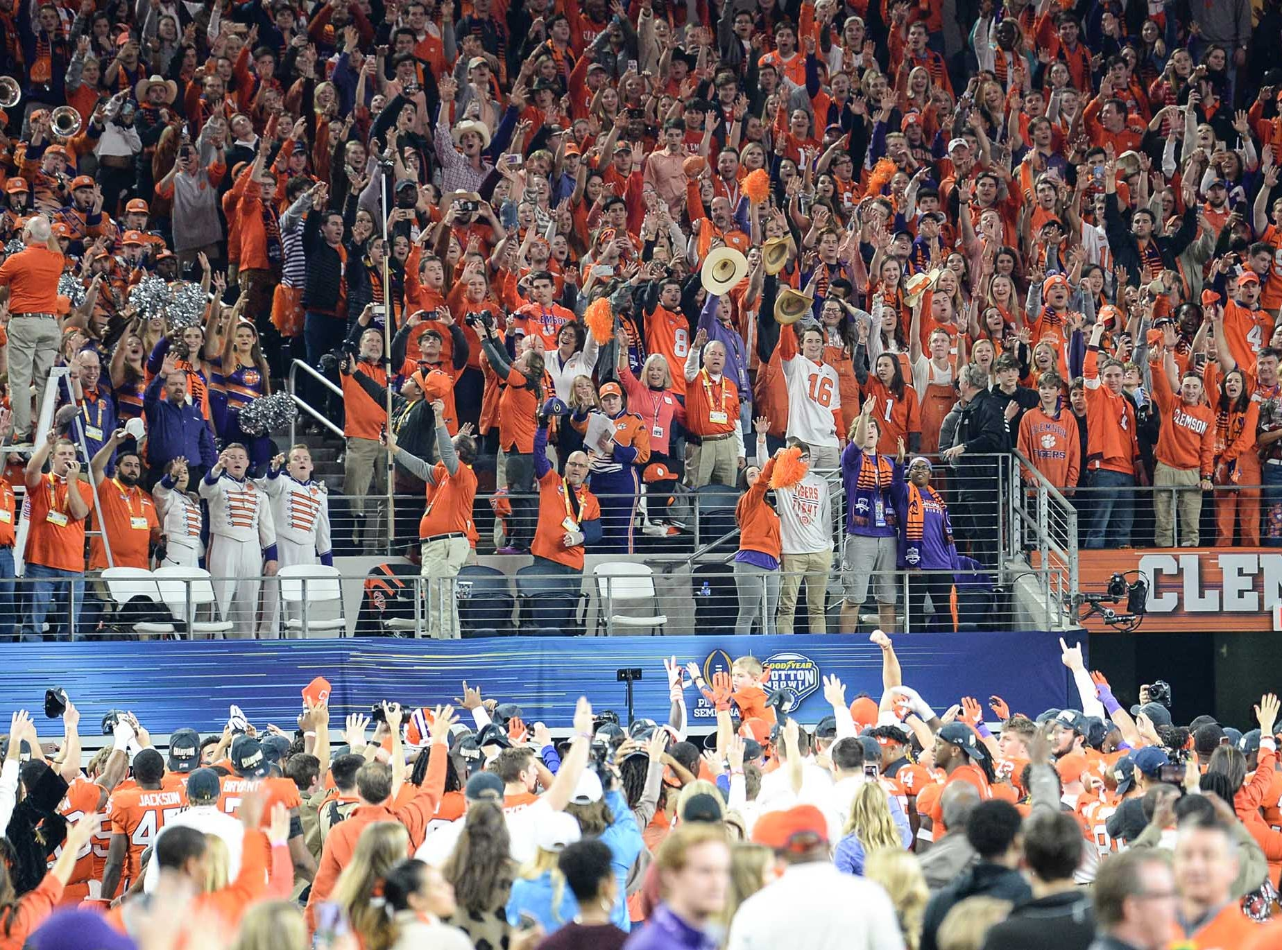 Clemson fans cheer with players after the College Football Playoff Semifinal 30-3 win over Notre Dame at the Goodyear Cotton Bowl Classic at AT&T Stadium in Arlington, Texas Saturday, December 29, 2018.