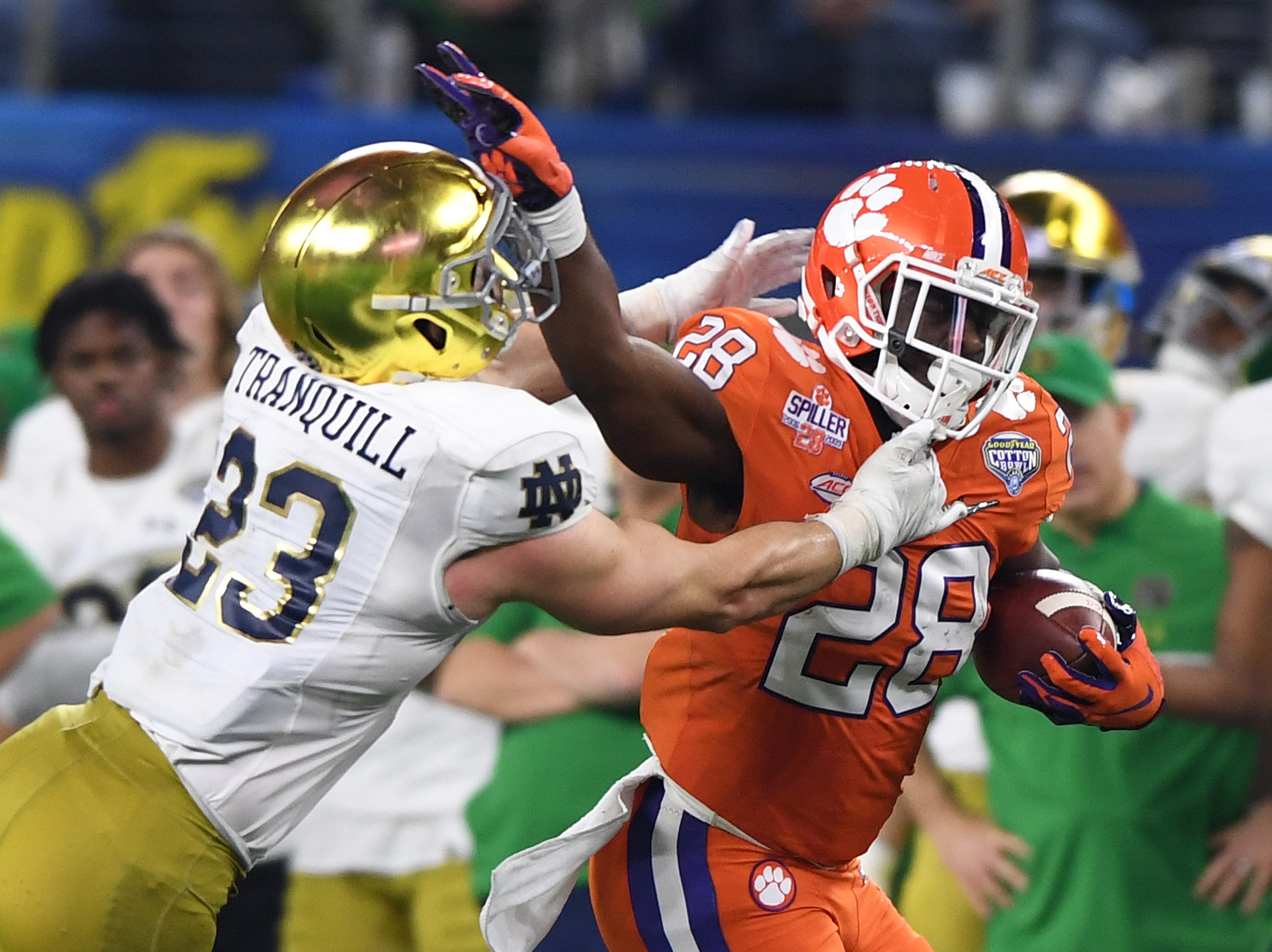 Notre Dame linebacker Drue Tranquill (23) tries to stop Clemson running back Tavien Feaster (28) during the 4th quarter of the Goodyear Cotton Bowl at AT&T stadium in Arlington, TX Saturday, December 29, 2018.