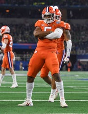 Clemson linebacker Shaq Smith (5) reacts after a defensive stop against Notre Dame during the 4th quarter of the Goodyear Cotton Bowl at AT&T stadium in Arlington, TX Saturday, December 29, 2018.