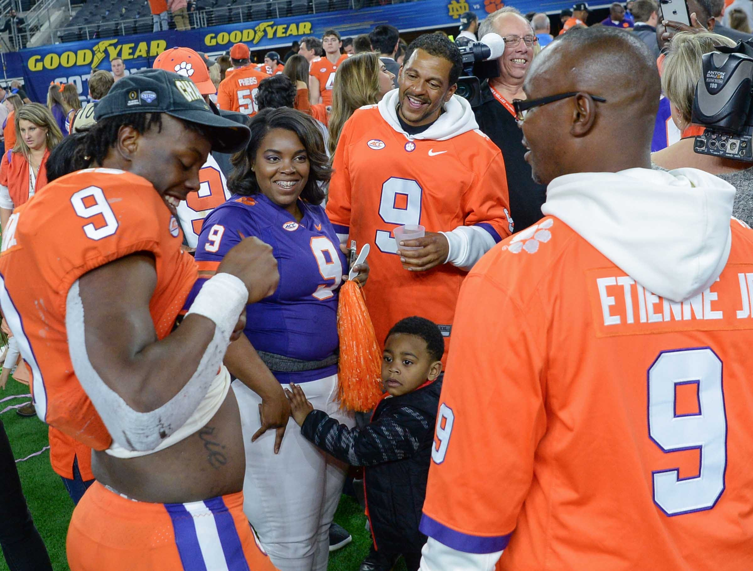 Clemson running back Travis Etienne (9) with family after the Tigers beat Notre Dame 30-3 in the College Football Playoff Semifinal at the Goodyear Cotton Bowl Classic at AT&T Stadium in Arlington, Texas Saturday, December 29, 2018.