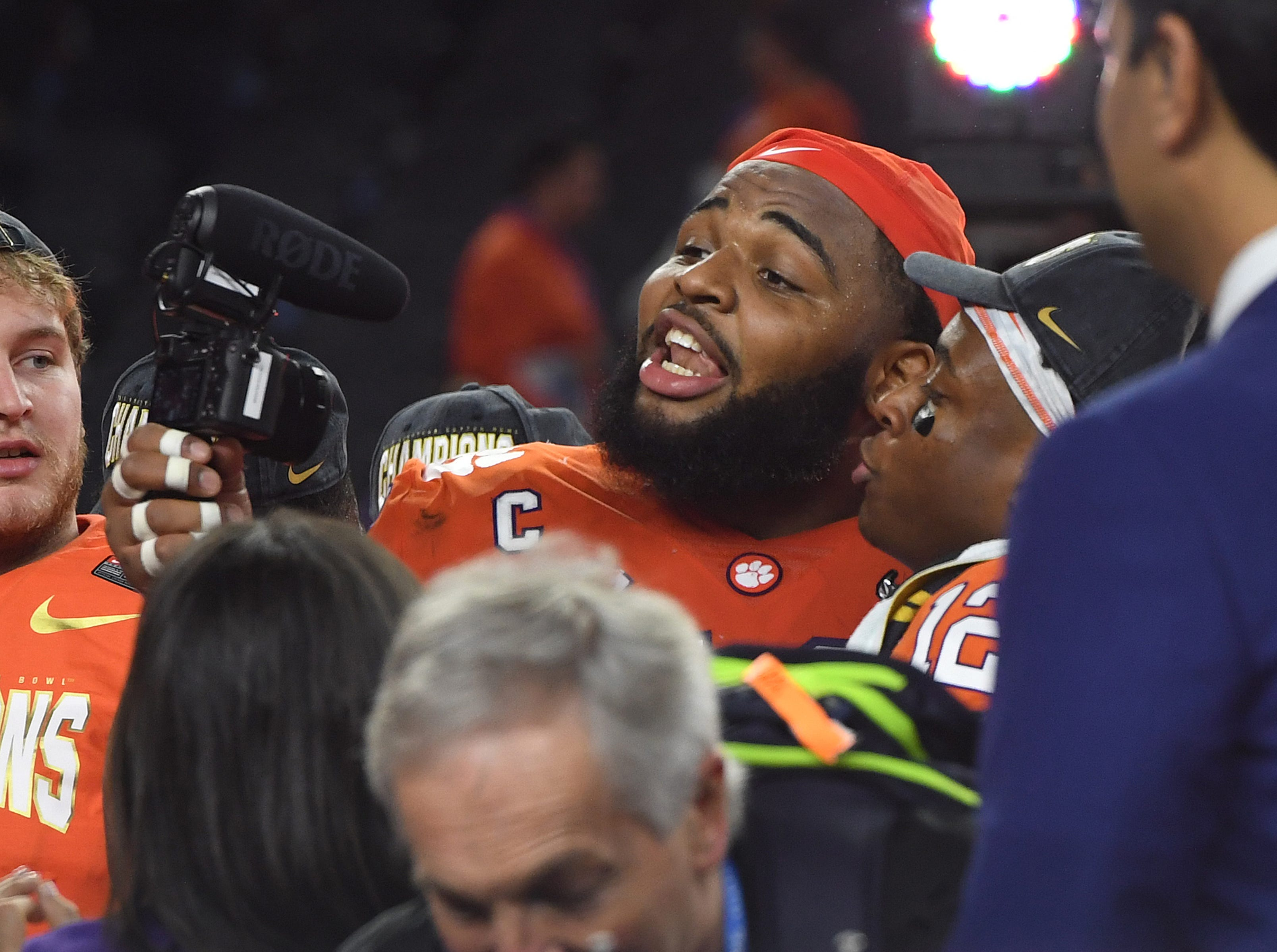 Clemson defensive lineman Christian Wilkins (42) celebrates after the Tigers 30-3 win over Notre Dame in the Goodyear Cotton Bowl at AT&T stadium in Arlington, TX Saturday, December 29, 2018.