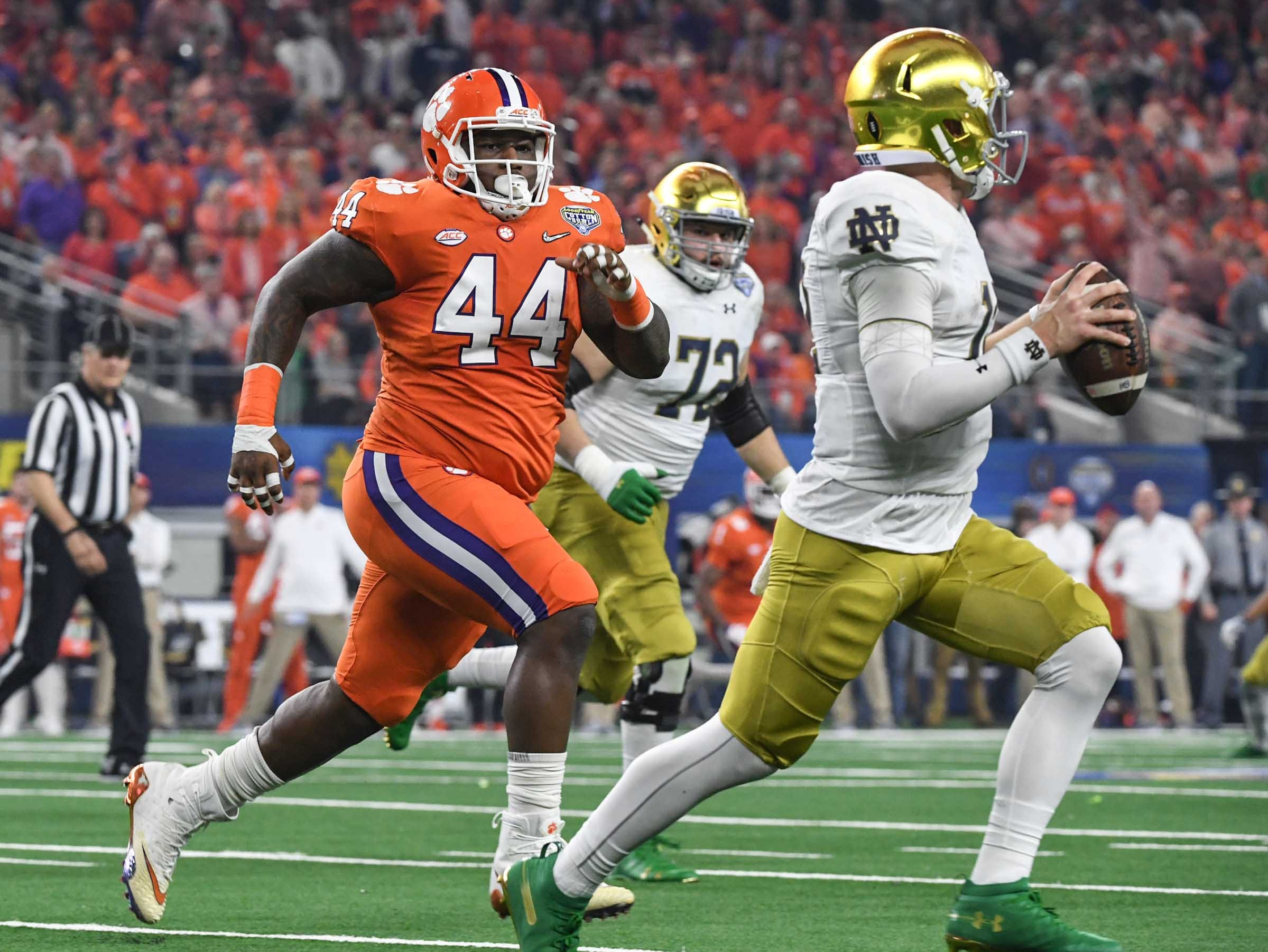 Clemson defensive tackle Nyles Pinckney (44) chases Notre Dame quarterback Ian Book (12) during the second quarter of the College Football Playoff Semifinal at the Goodyear Cotton Bowl Classic at AT&T Stadium in Arlington, Texas Saturday, December 29, 2018.