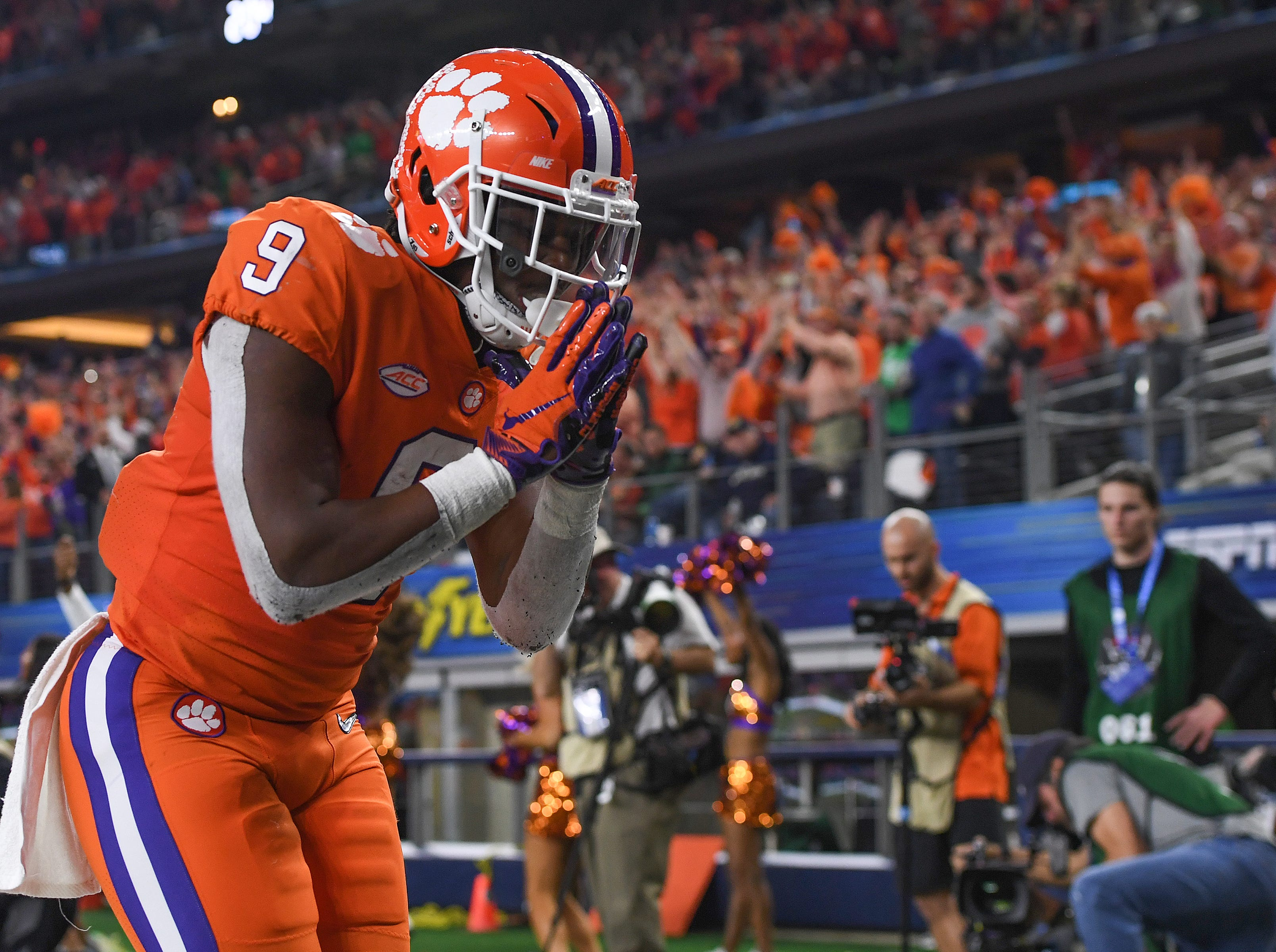 Clemson running back Travis Etienne (9) bows after scoring on a 62 yard TD carry against Notre Dame during the 3rd quarter of the Goodyear Cotton Bowl at AT&T stadium in Arlington, TX Saturday, December 29, 2018.