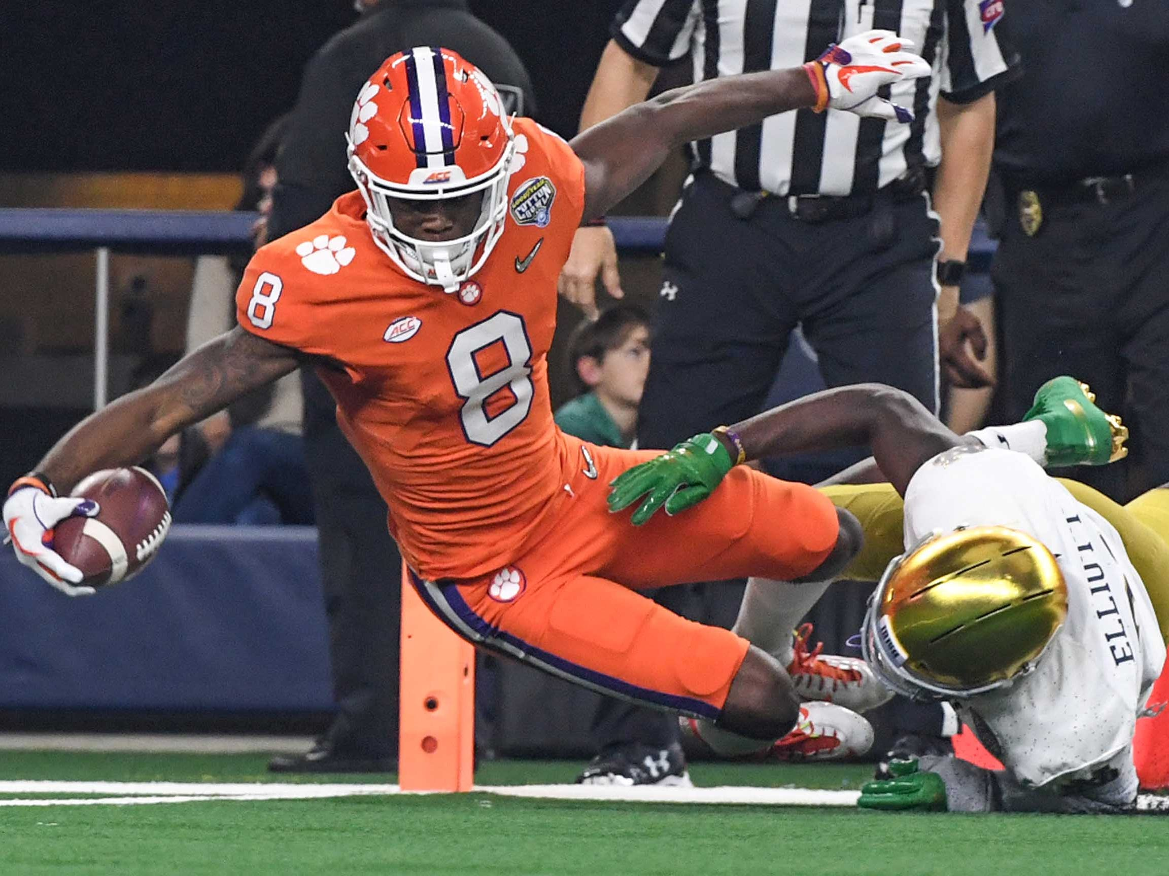 Clemson wide receiver Justyn Ross (8) scores by Notre Dame safety Jalen Elliott (21) for a 52-yard touchdown during the second quarter of the College Football Playoff Semifinal at the Goodyear Cotton Bowl Classic at AT&T Stadium in Arlington, Texas Saturday, December 29, 2018.