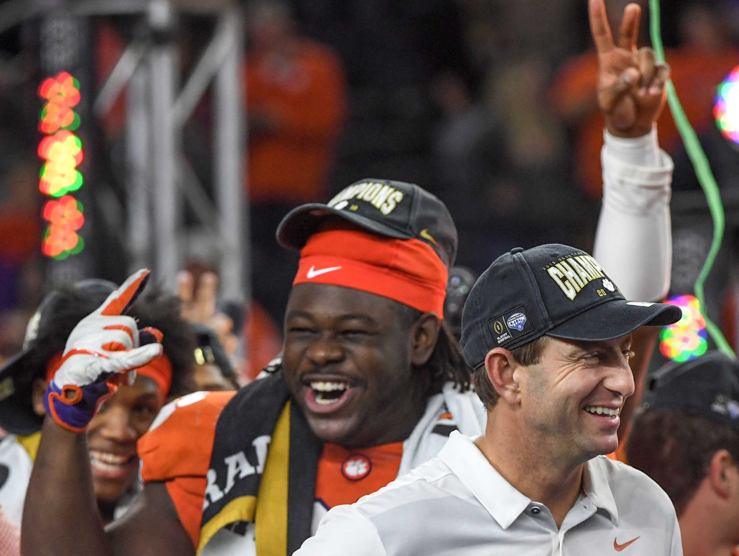 Clemson defensive lineman Albert Huggins and Clemson Head Coach Dabo Swinney celebrate after their 30-3 win over Notre Dame in the College Football Playoff Semifinal at the Goodyear Cotton Bowl Classic at AT&T Stadium in Arlington, Texas Saturday, December 29, 2018.