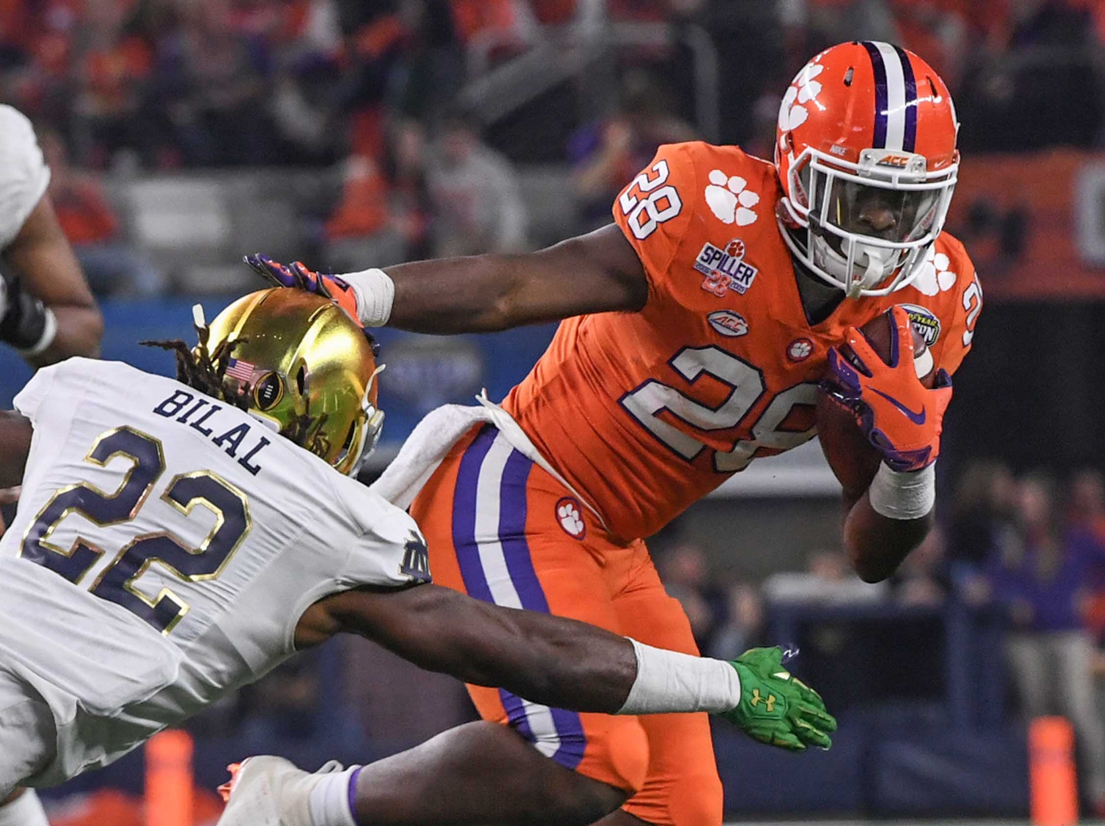 Clemson running back Tavien Feaster (28) runs by Notre Dame linebacker Asmar Bilal (22) during the fourth quarter of the College Football Playoff Semifinal at the Goodyear Cotton Bowl Classic at AT&T Stadium in Arlington, Texas Saturday, December 29, 2018.